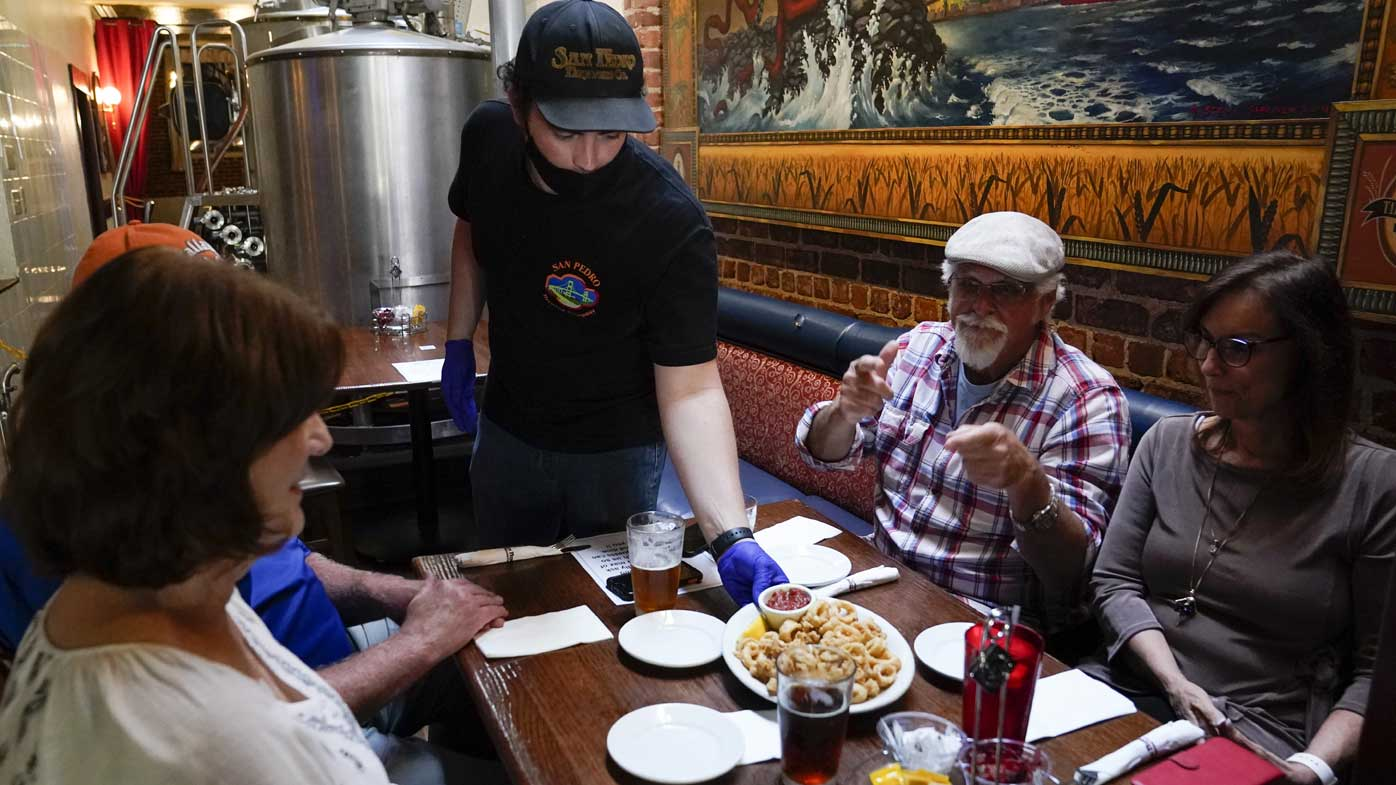 Coronavirus cases are hitting record highs in California, where restaurants are reopening.