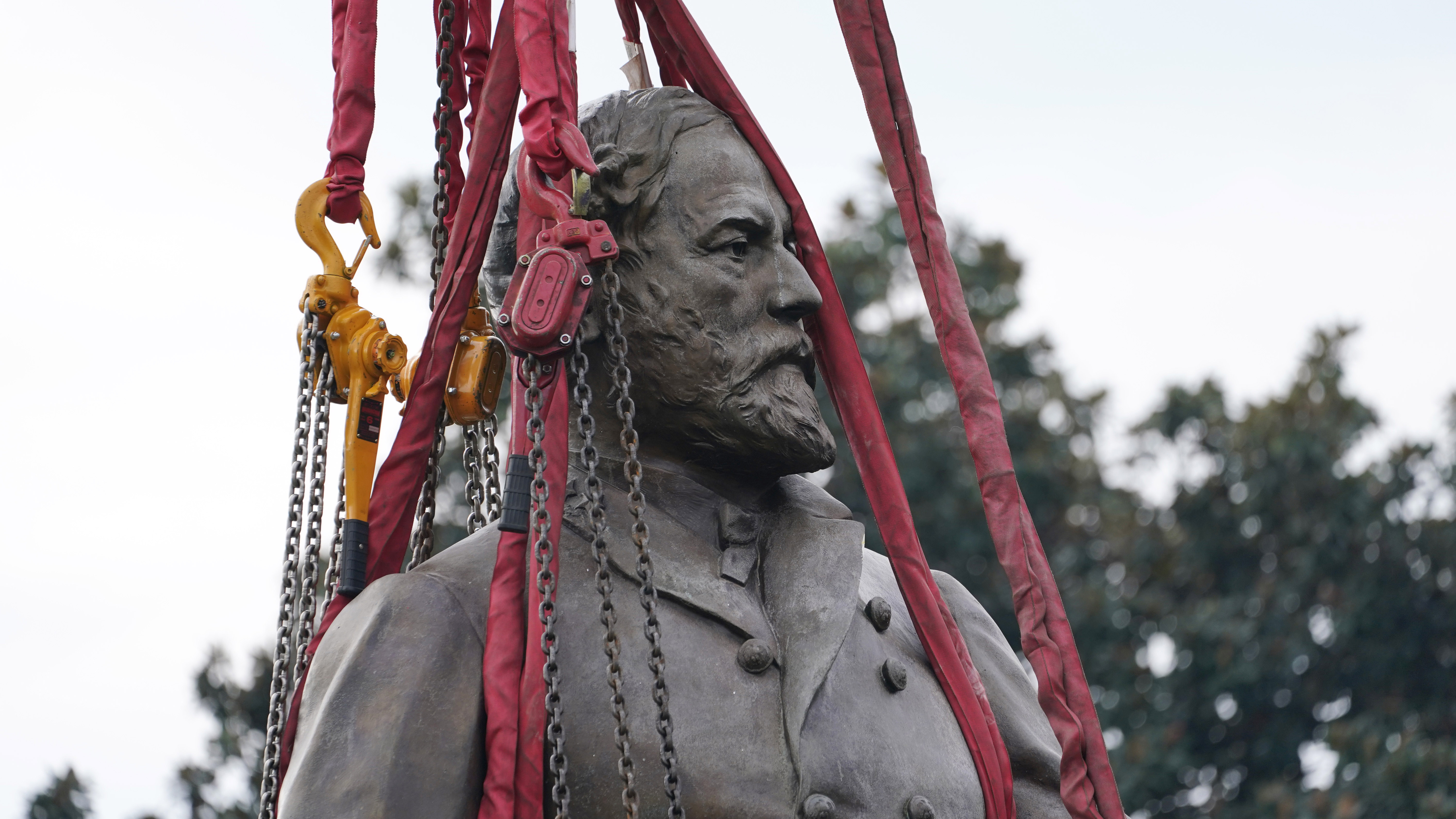 Lifting straps surrounded the statue of Confederate General Robert E. Lee as crews removed it.