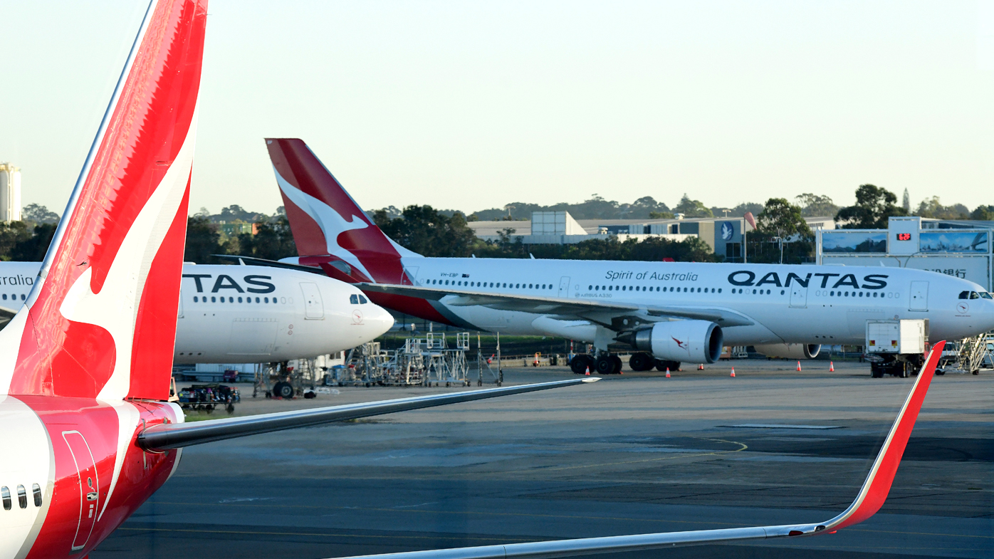 Qantas aircraft are seen on the tarmac at Sydney Airport.