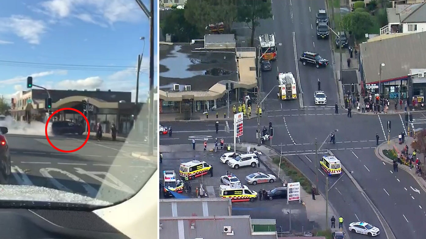 Driver in custody after car slams into shopfront