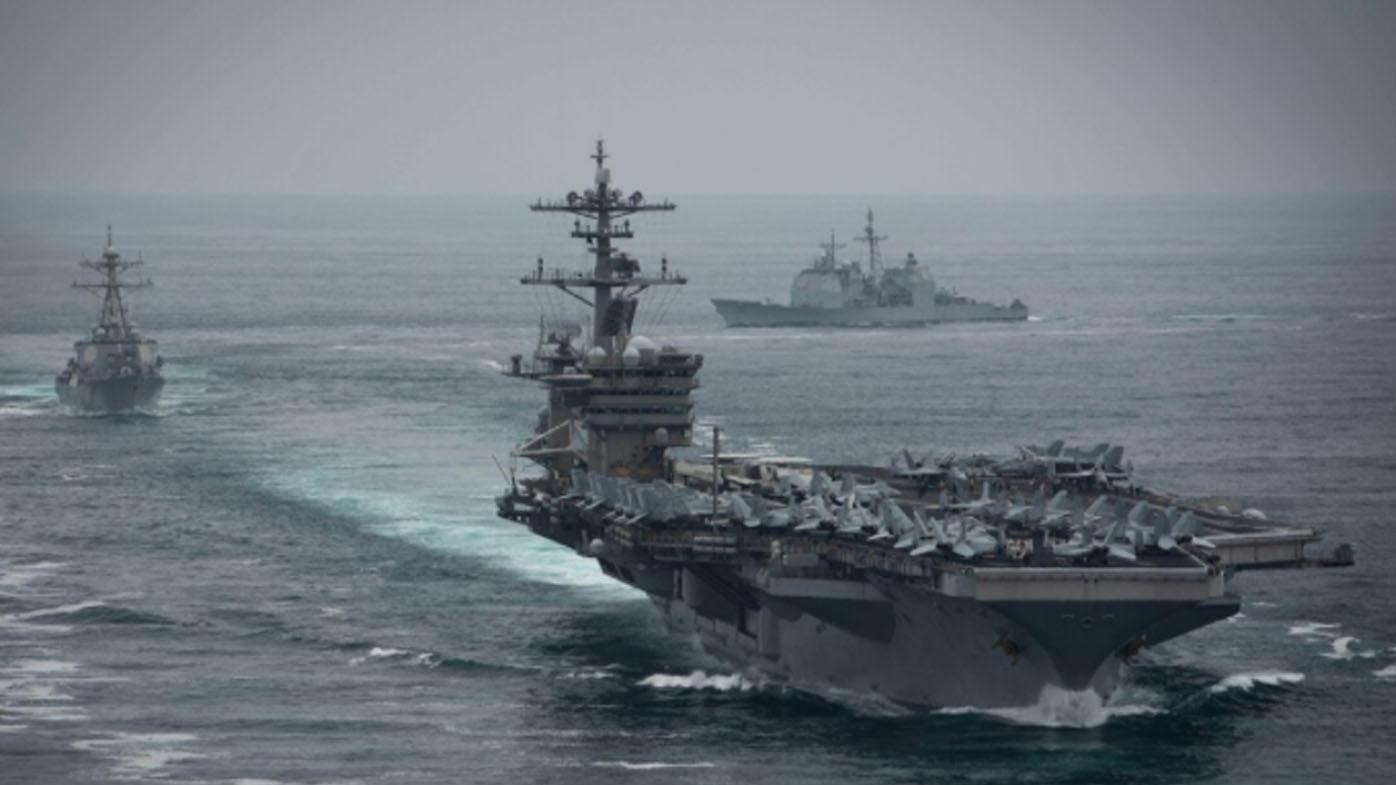 China hold naval drills, warns US