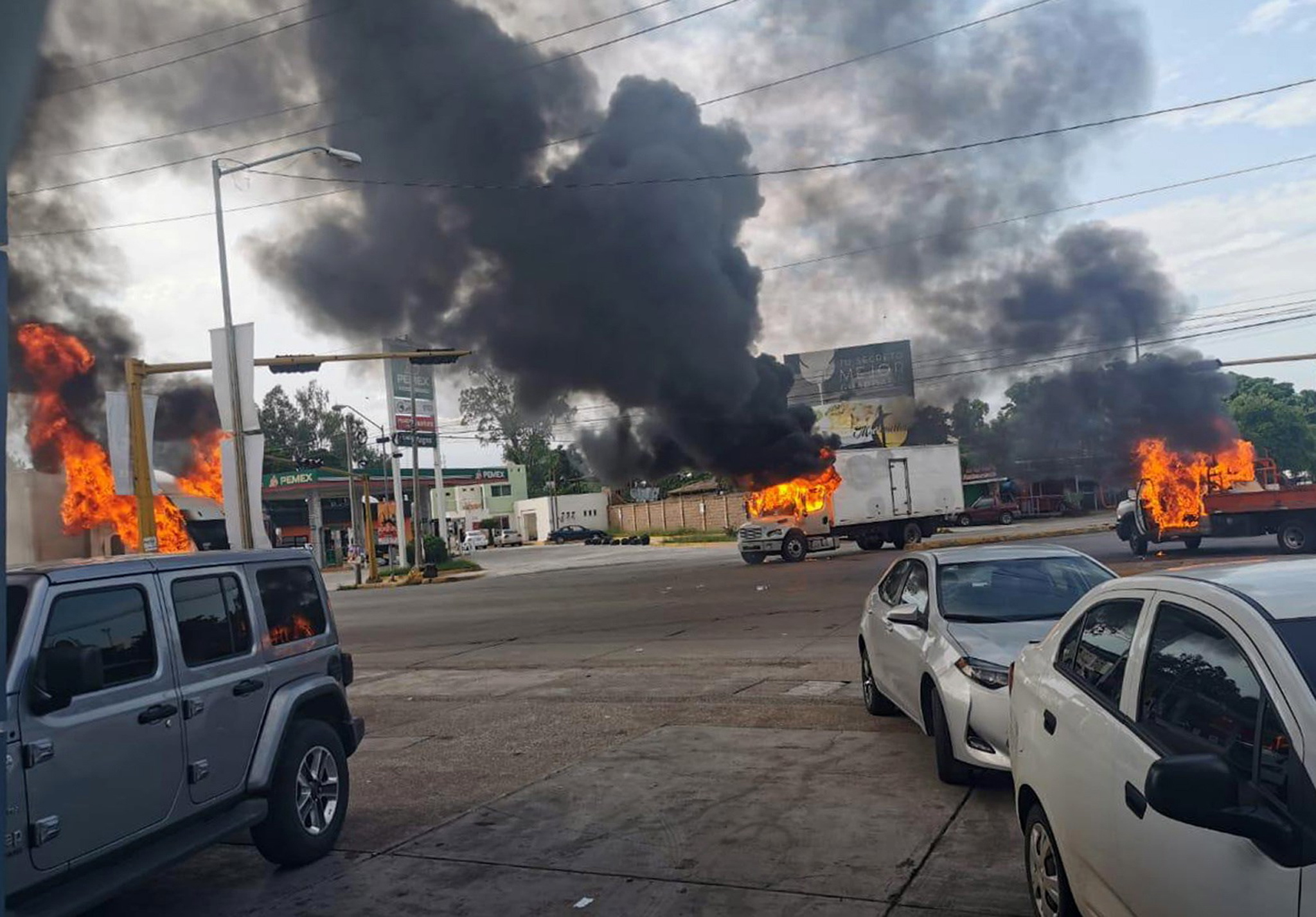 Vehicles on fire during a clash between armed gunmen and Federal police and military soldiers, in the streets of the city of Culiacan, Sinaloa state, Mexico.