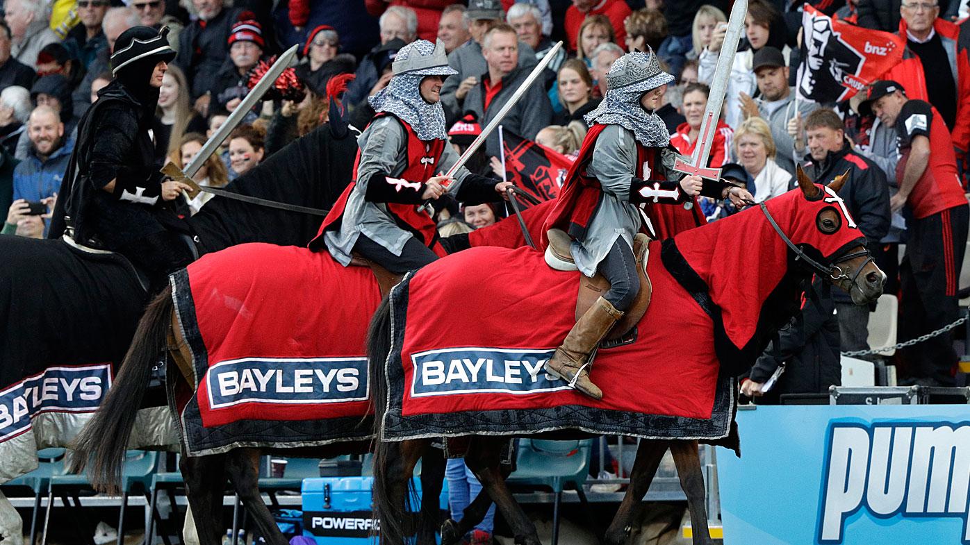 The Crusader horseman ride around the arena