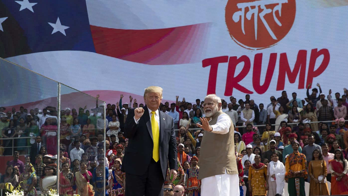 """Mr Trump and Indian Prime Minister Narendra Modi wave after the """"Namaste Trump"""" event."""