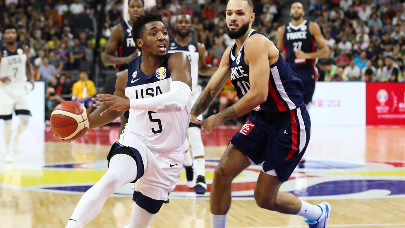 Donovan Mitchell of USA in action against Evan Fournier #10 of France