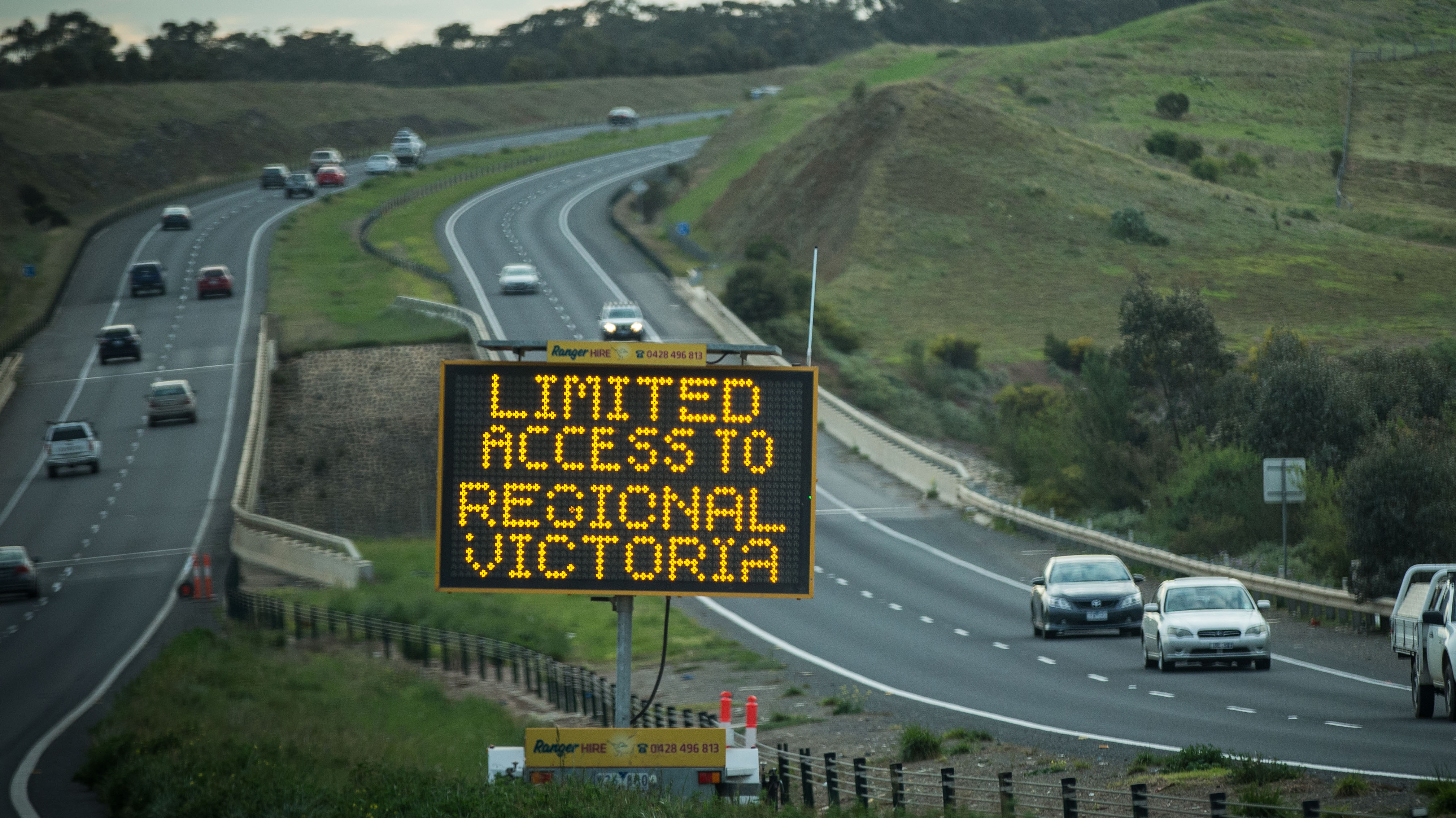 A traffic sign with restriction warnings stand on the Western Highway between Melbourne and Ballarat.