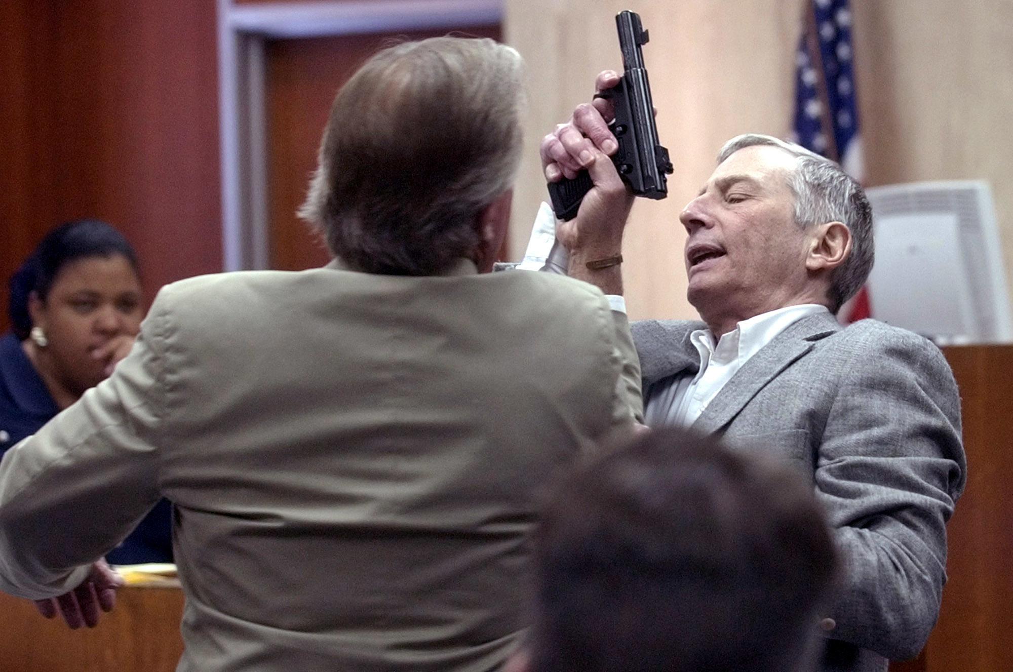 Multi-millionaire murder defendant Robert Durst and his attorney Dick DeGuerin demonstrate how Durst struggled with Morris Black during 2003 testimony in Galveston, Texas.