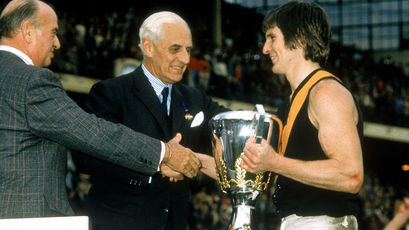 Royce Hart of the Tigers holds the 1974 trophy after the VFL Grand Final. (Getty)
