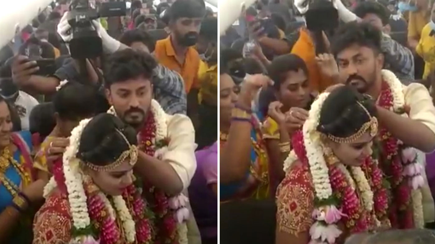 Video posted to social media shows a packed plane full of people apparently celebrating a wedding mid-air to bypass coronavirus restrictions in India.