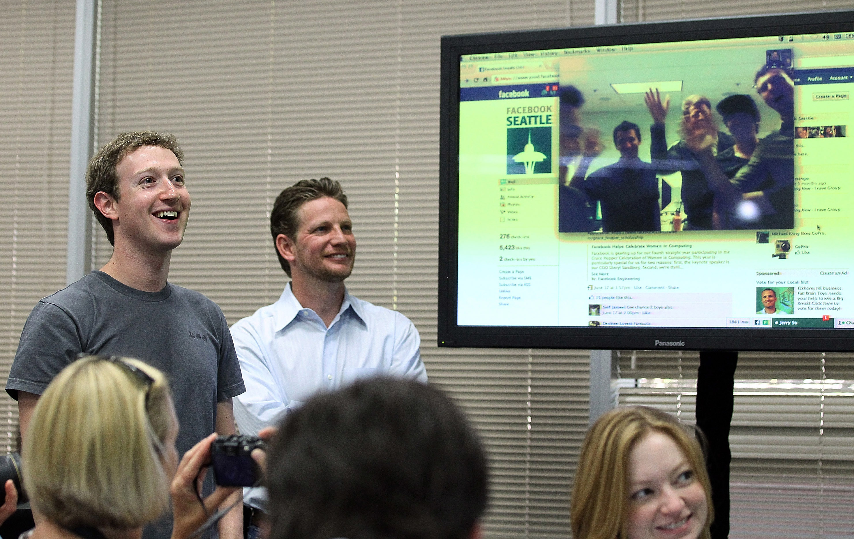 Facebook CEO Mark Zuckerberg watches a demonstration of Facebook video chat at Facebook headquarters in 2011.