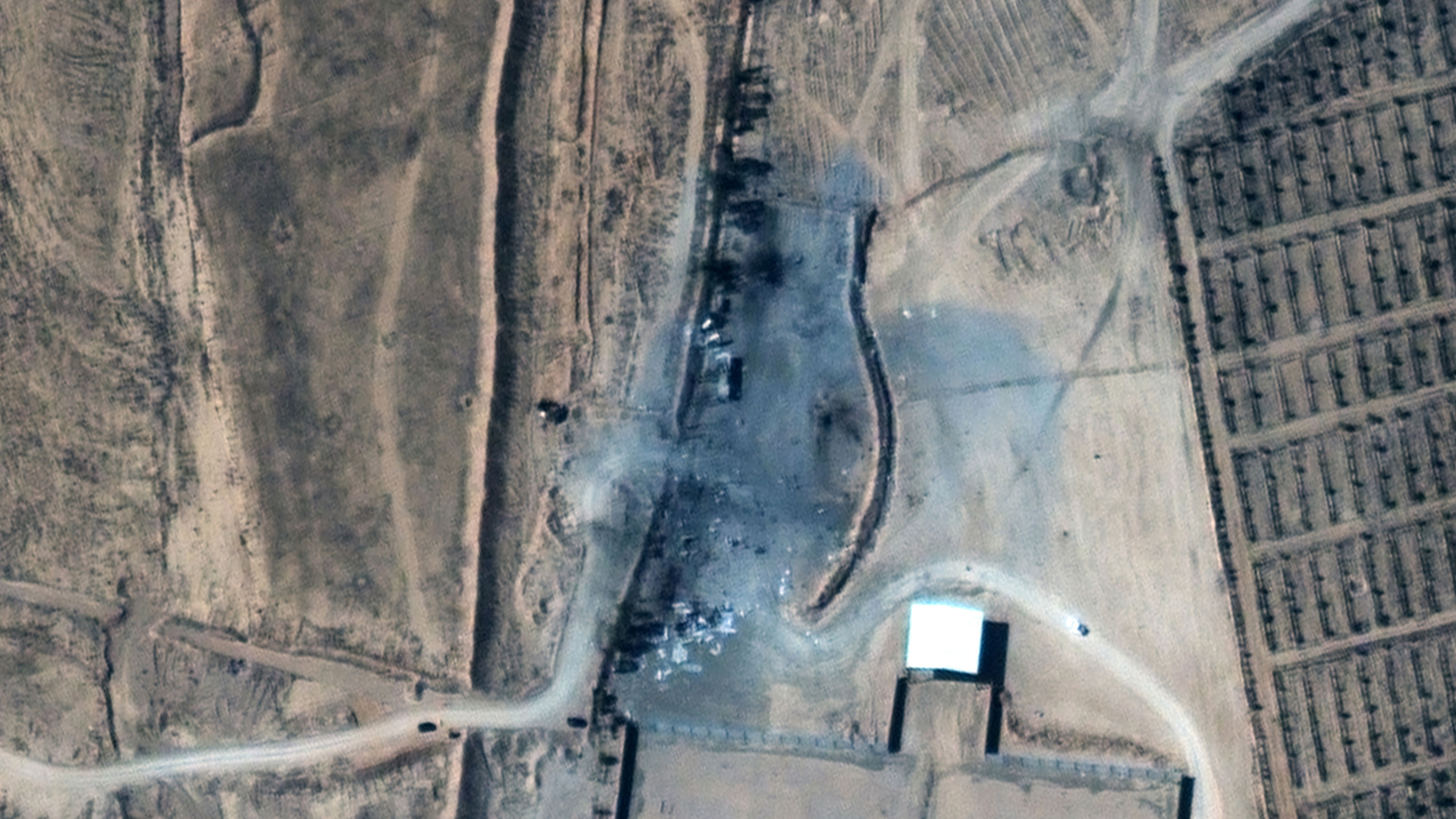 This satellite image after the deployment shows buildings destroyed.