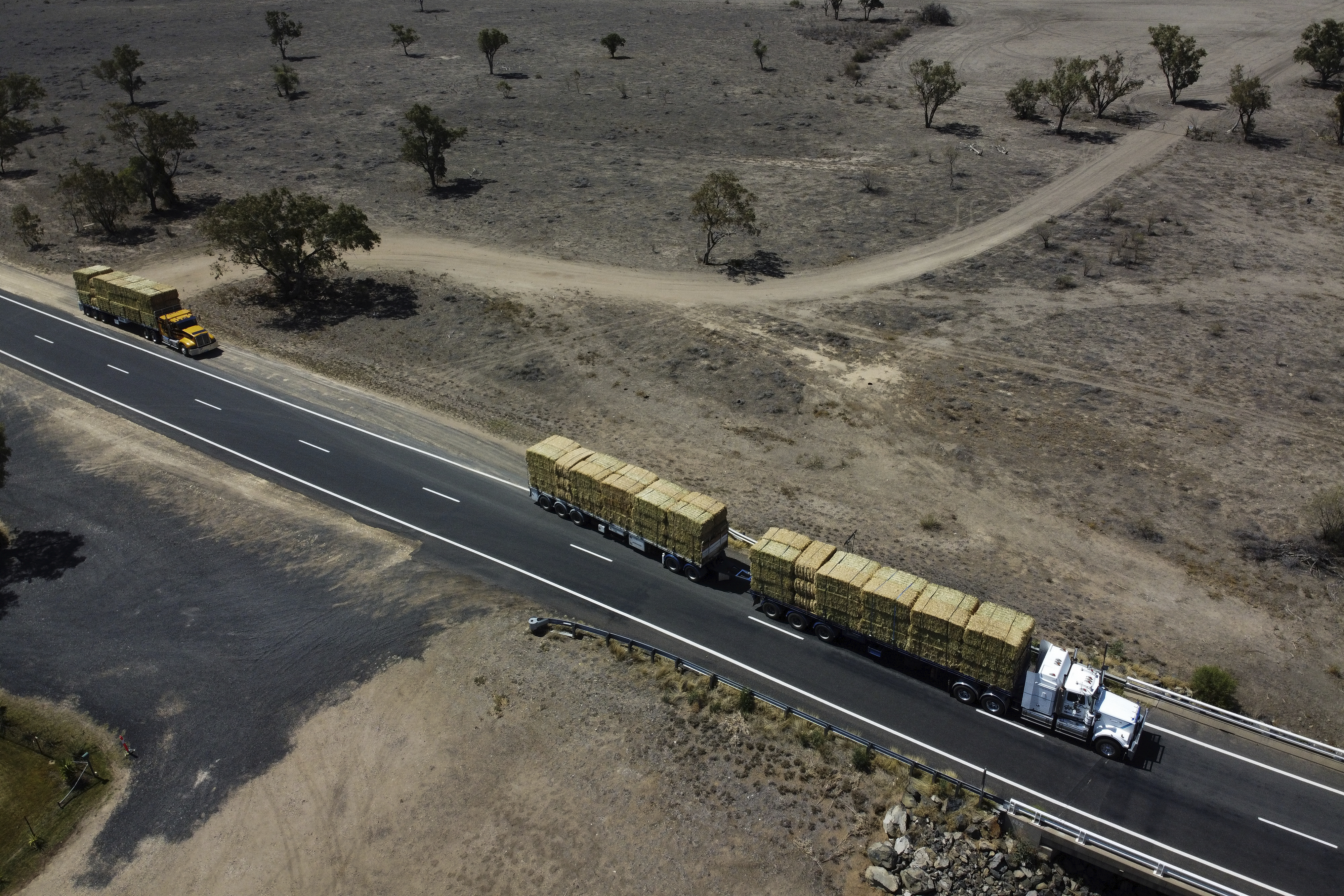 Trucks on the Gwydir highway transporting hay from Bendigo, Victoria to drought-affected parts of Queensland, seen near Bullarah, NSW, on Wednesday 20 November 2019. Photo: Alex Ellinghausen