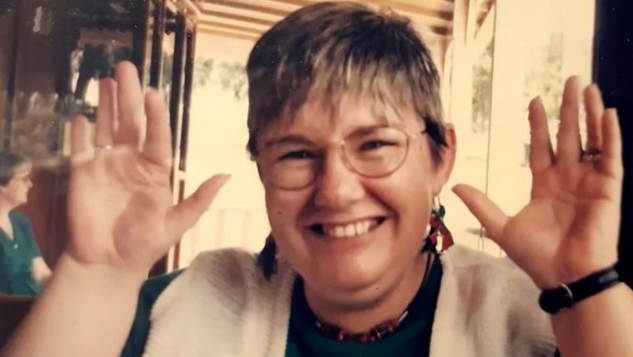 Susan Fisher, 64, from Macquarie Fields in the city's south-west, died in Liverpool Hospital after catching the virus from a nurse.