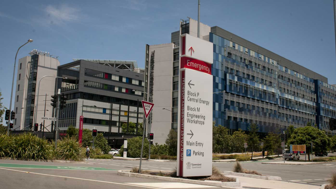 The woman is in isolation at Gold Coast University Hospital.