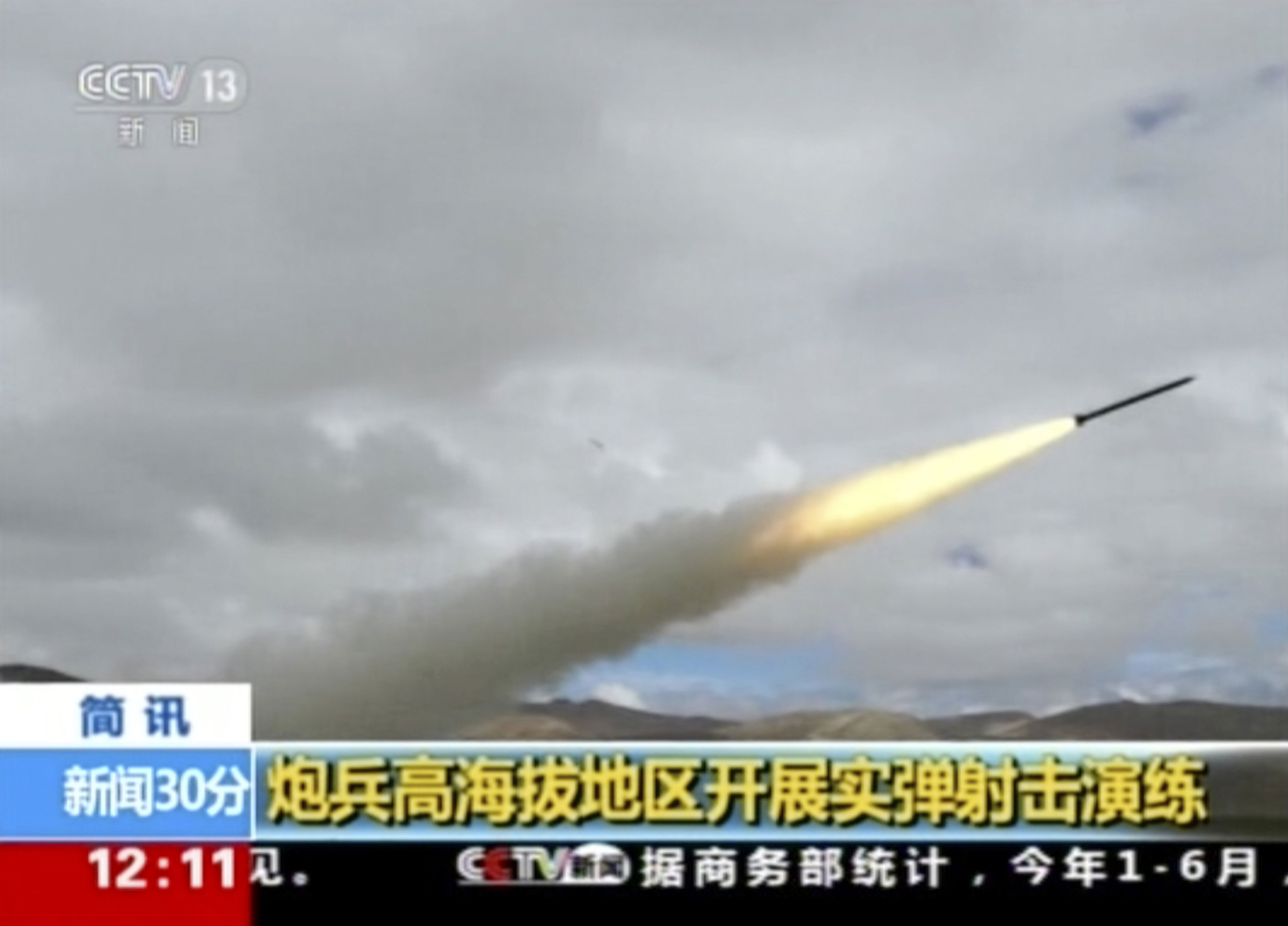 In this image taken from a recent video footage run by China's CCTV on Friday, Aug 4, 2017 via AP Video, a rocket is launched during a live-fire drill by the Chinese army in China's Tibet Autonomous Region that border India. Beijing is intensifying its warnings to Indian troops to get out of a contested region high in the Himalayas where China, India and Bhutan meet