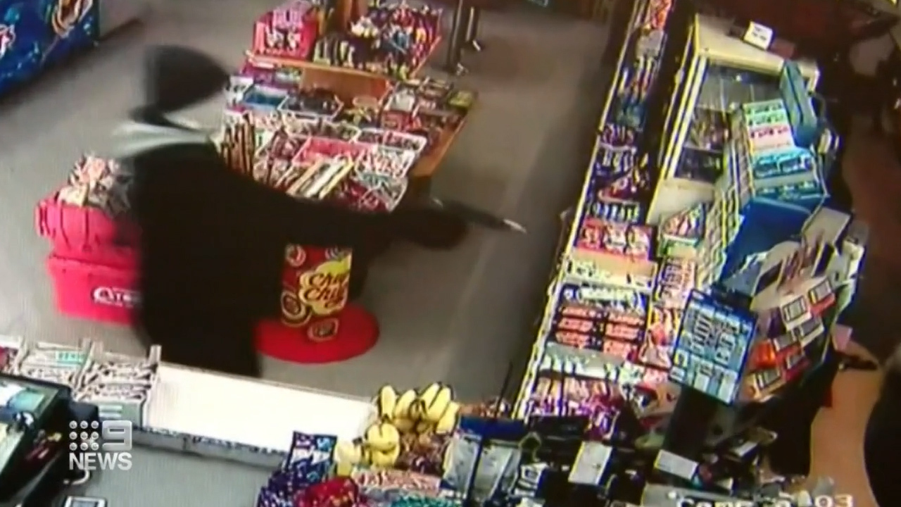 In CCTV video from inside the store the masked man can be seen entering, armed with what appears to be a gun.