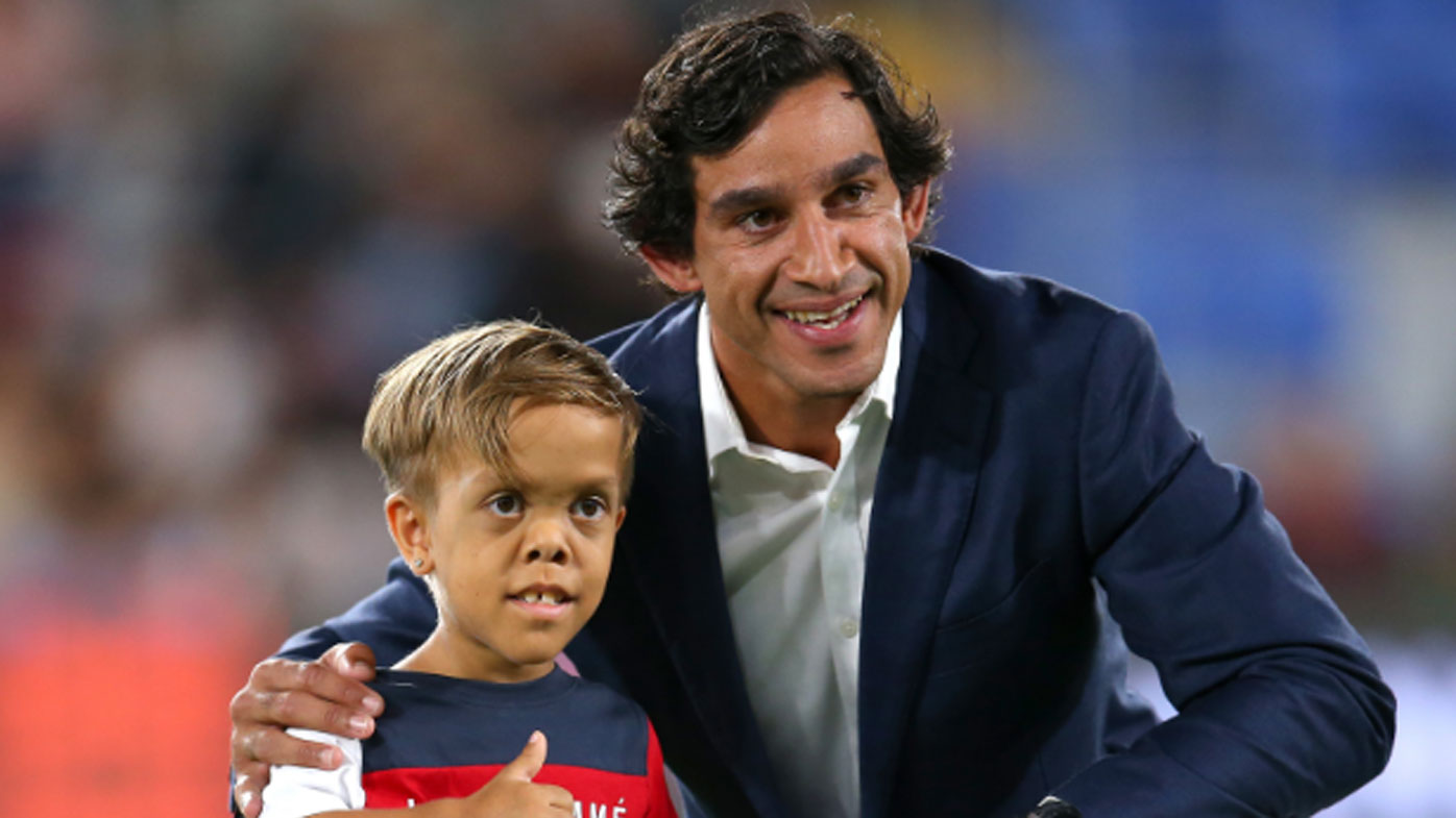Former rugby league player Johnathan Thurston poses with Quaden Bayles.