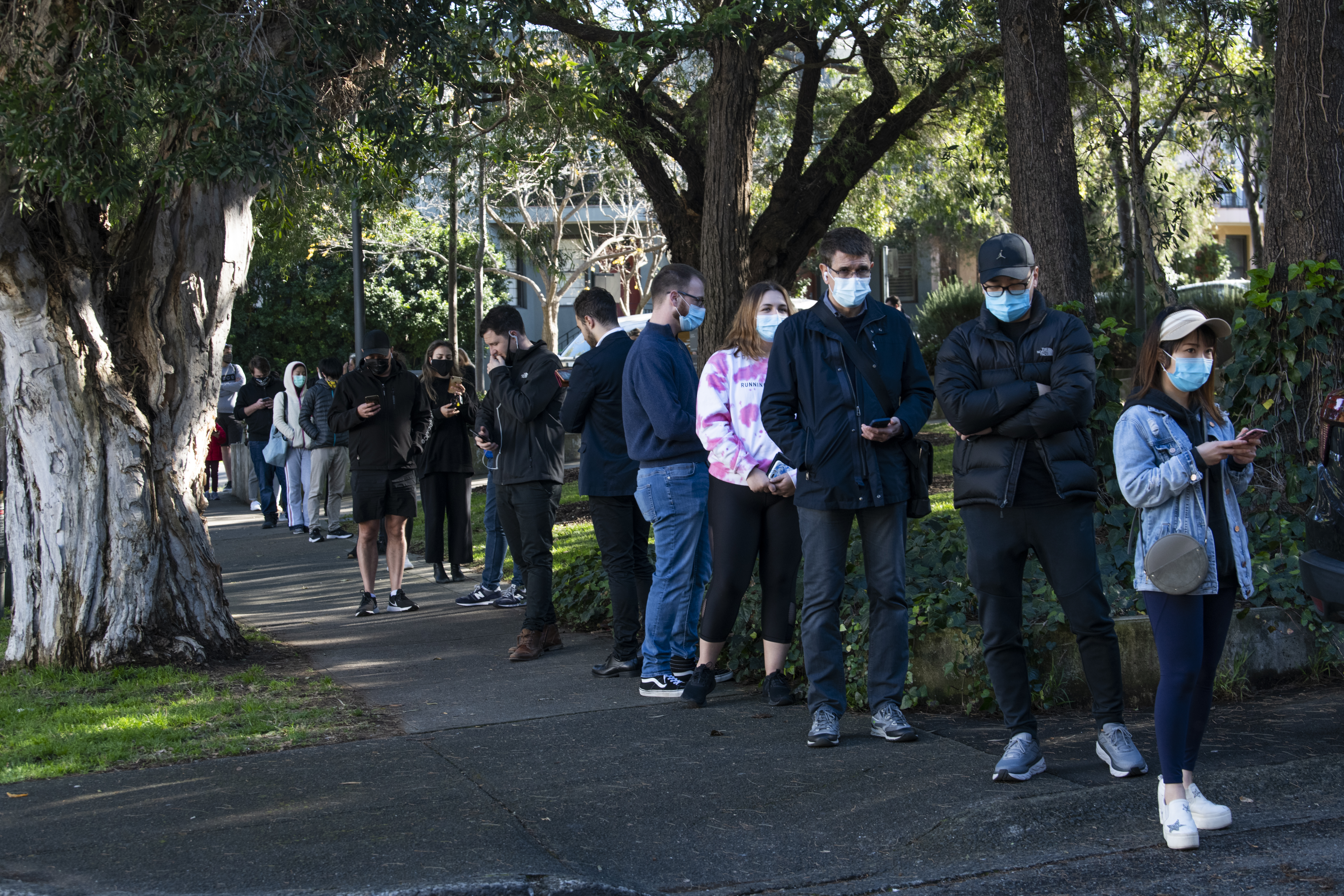 People queuing for a COVID test at a pop up clinic on Beaconsfield St, Alexandria after two local acquired COVID-19 cases were detected.
