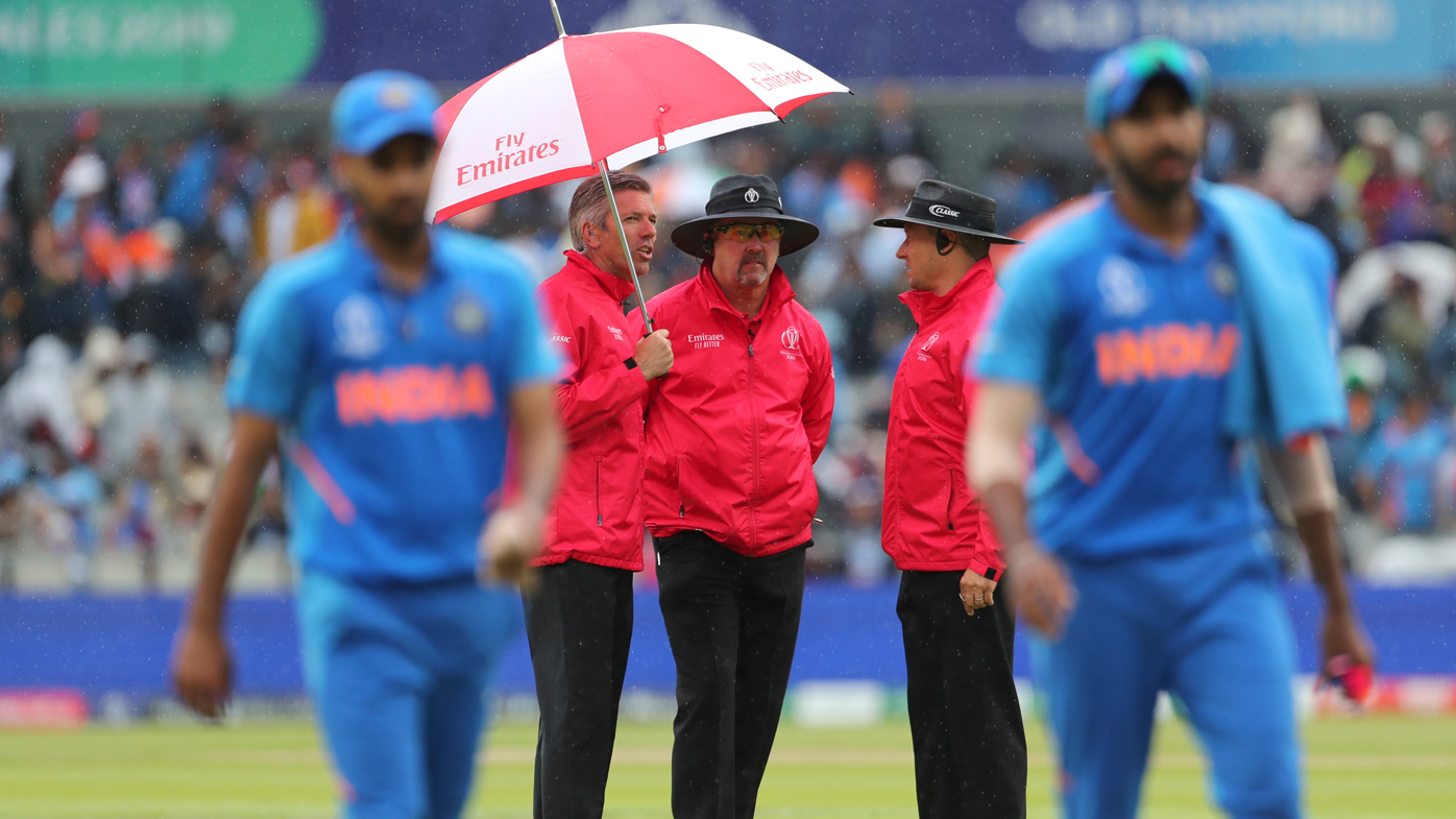 India players leave the field as umpires inspect the conditions at Old Trafford