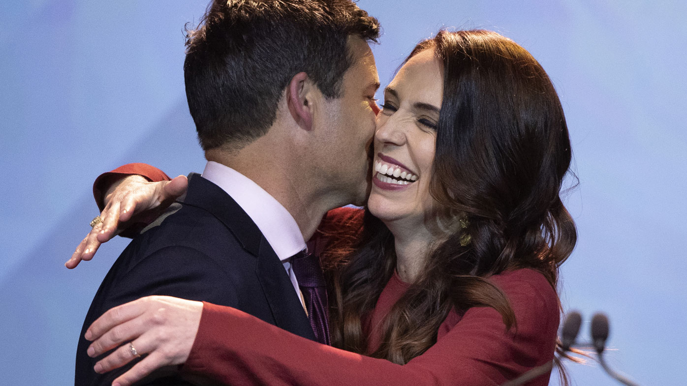 New Zealand Prime Minister Jacinda Ardern, right, is congratulated by her partner Clarke Gayford following her victory speech to Labour Party members at an event in Auckland, New Zealand, Saturday, Oct. 17, 2020