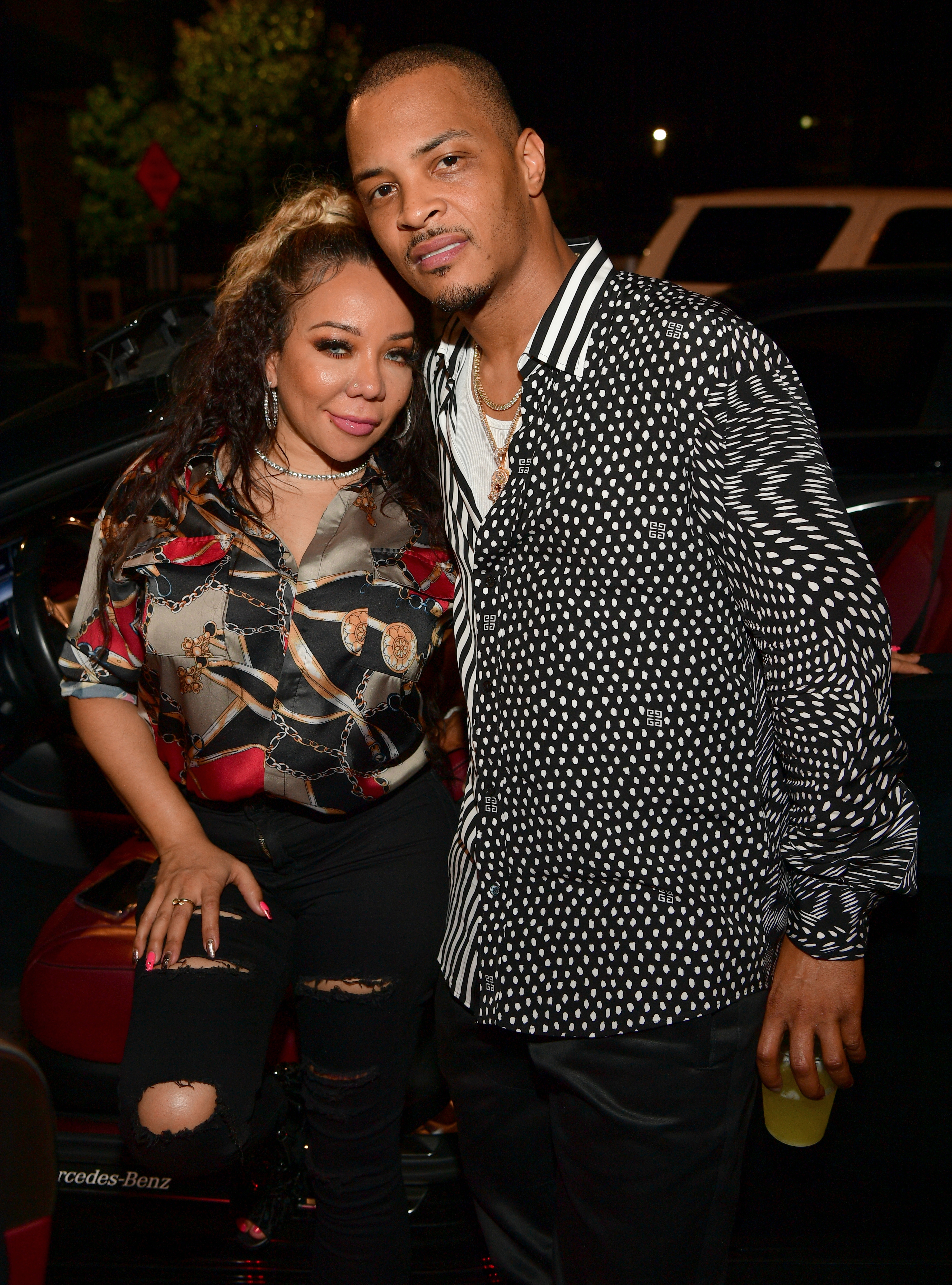 """Tameka Harris and T.I. attend the """"Dime Trap"""" Album release event at The Trap Museum on October 4, 2018 in Atlanta, Georgia."""