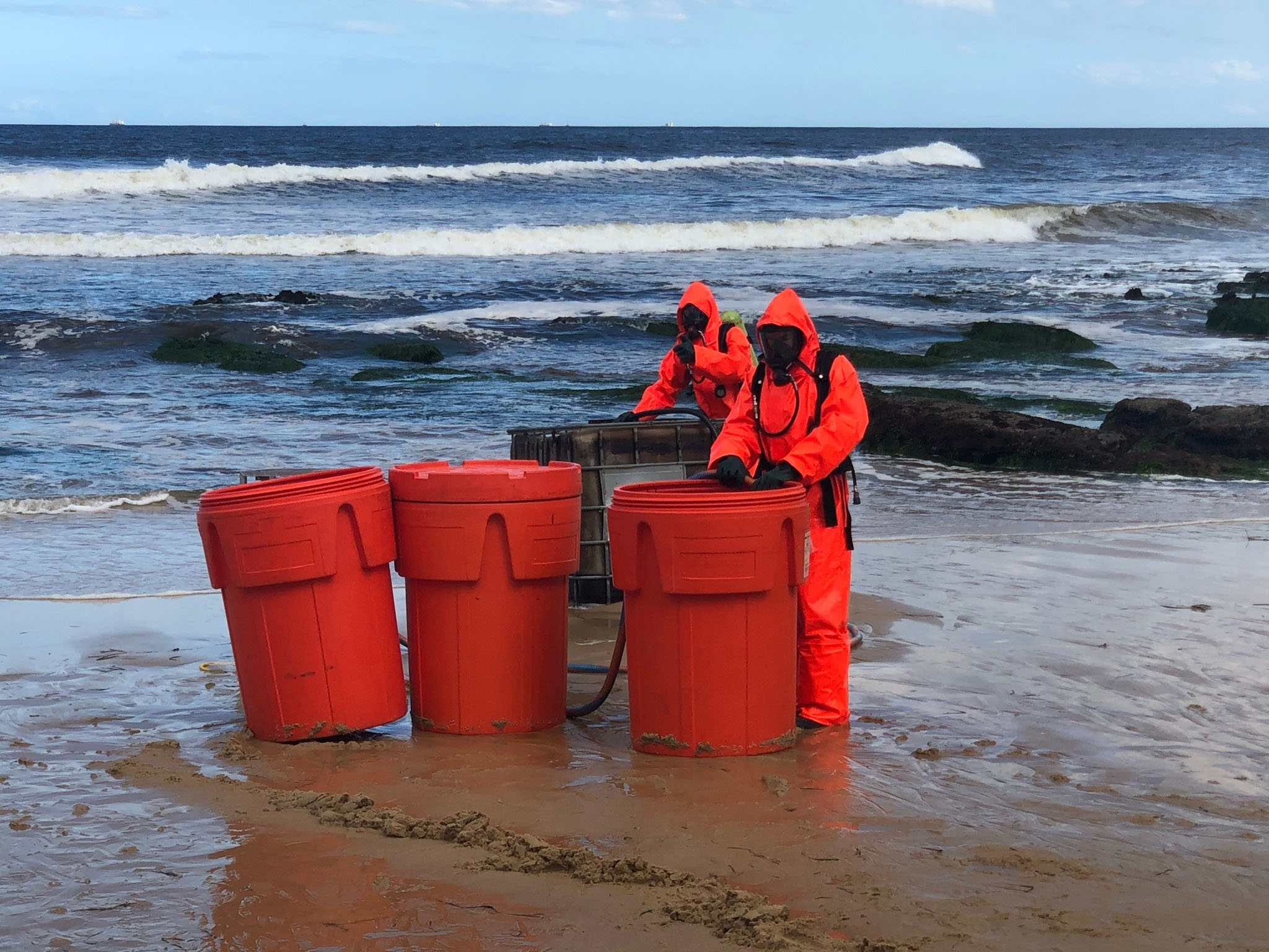 Mysterious drum containing acid forces evacuation of NSW beach