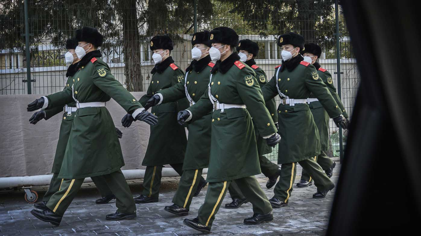 Police march wearing masks during a duty change on February 3, 2020 in Beijing, China.