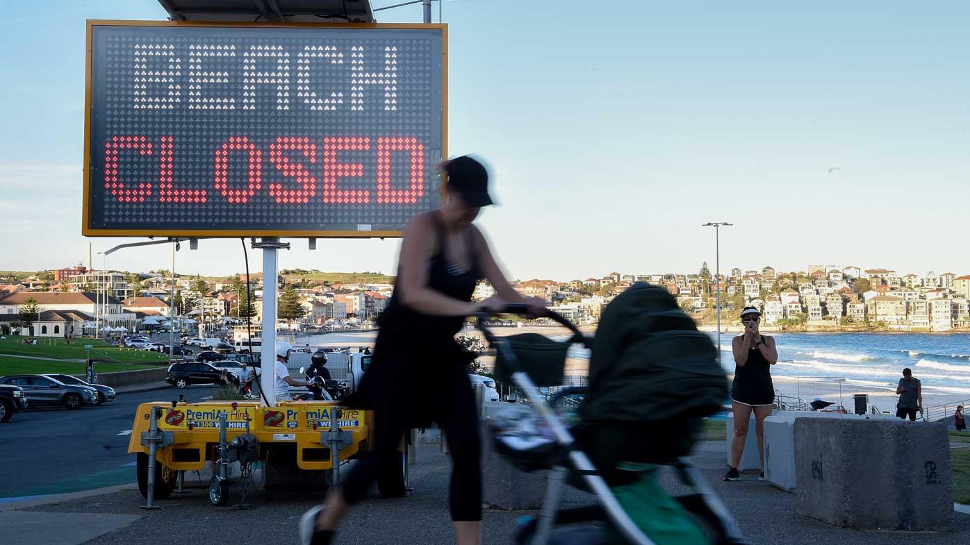 A 'beach closed' sign is seen at Bondi Beach in Sydney.