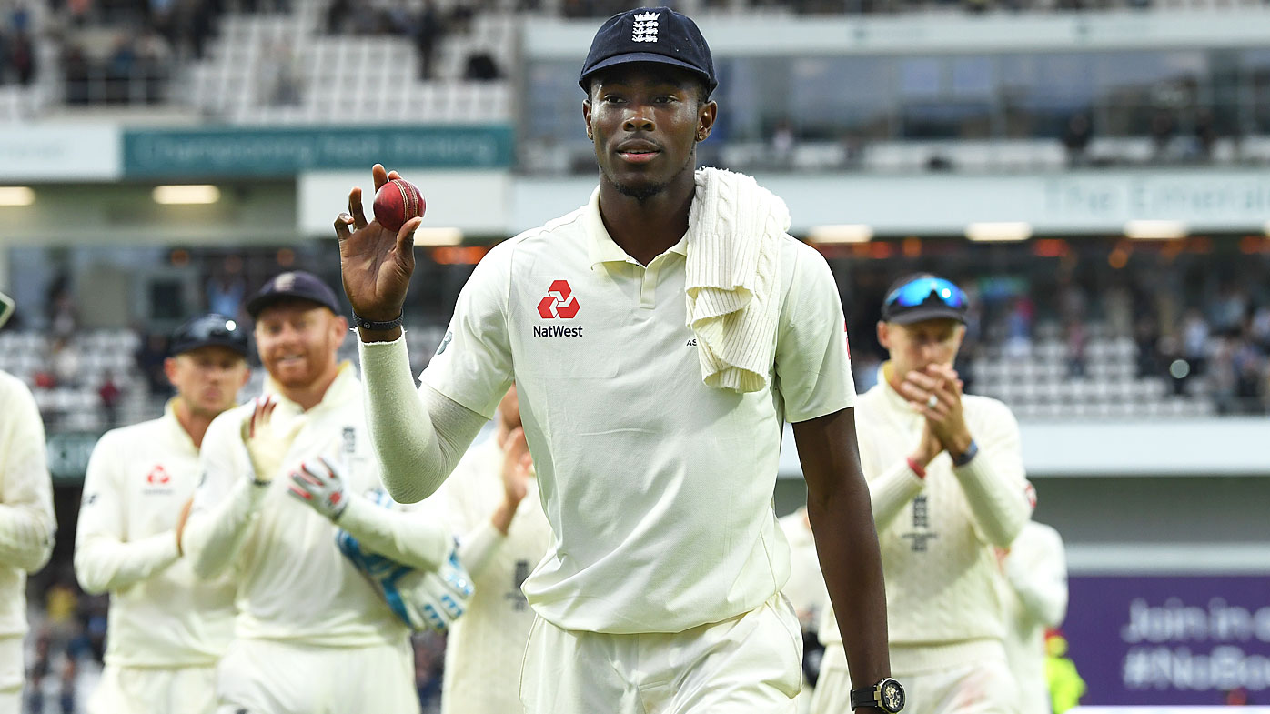 England bowler Jofra Archer leaves the field holding the ball after claiming 6 wickets during day one of the 3rd Ashes Test at Headingley