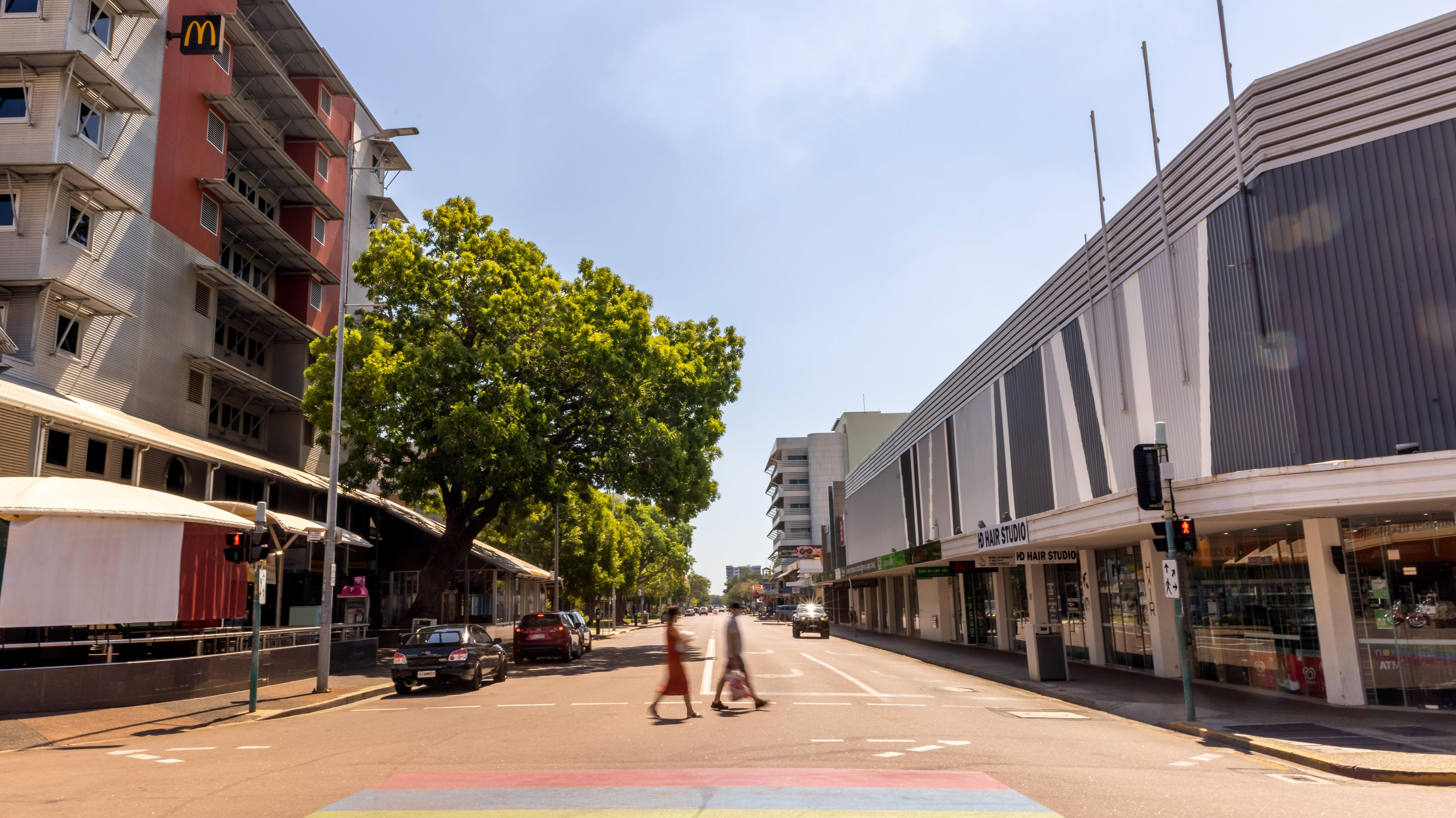 People walk along Mitchell Street during lockdown in Darwin, NT.