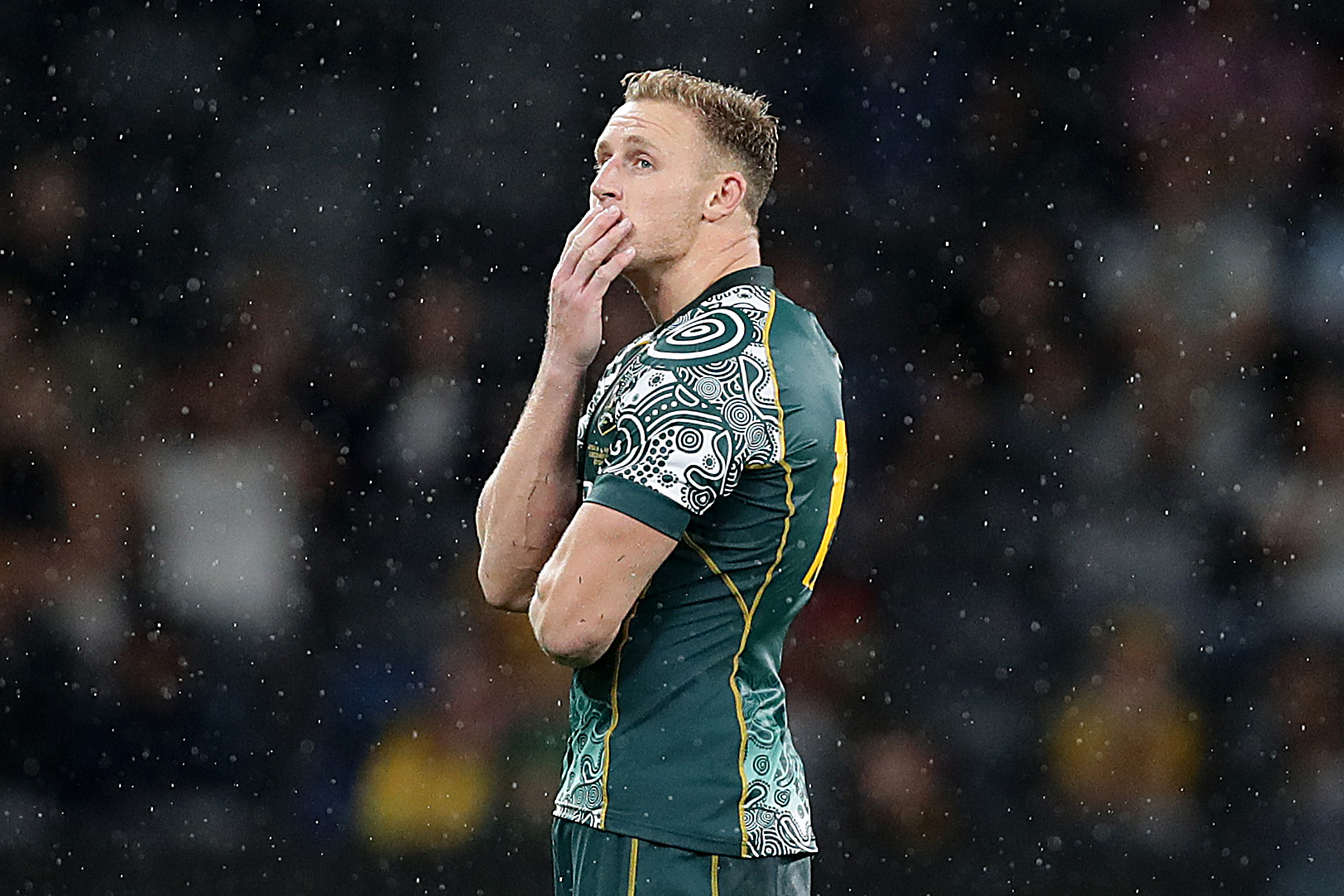Reece Hodge of the Wallabies reacts after missing a late kick at goal.
