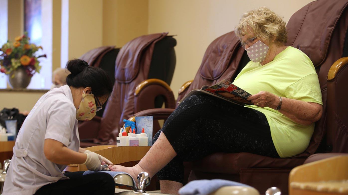 US states ease coronavirus lockdown, people get pedicures