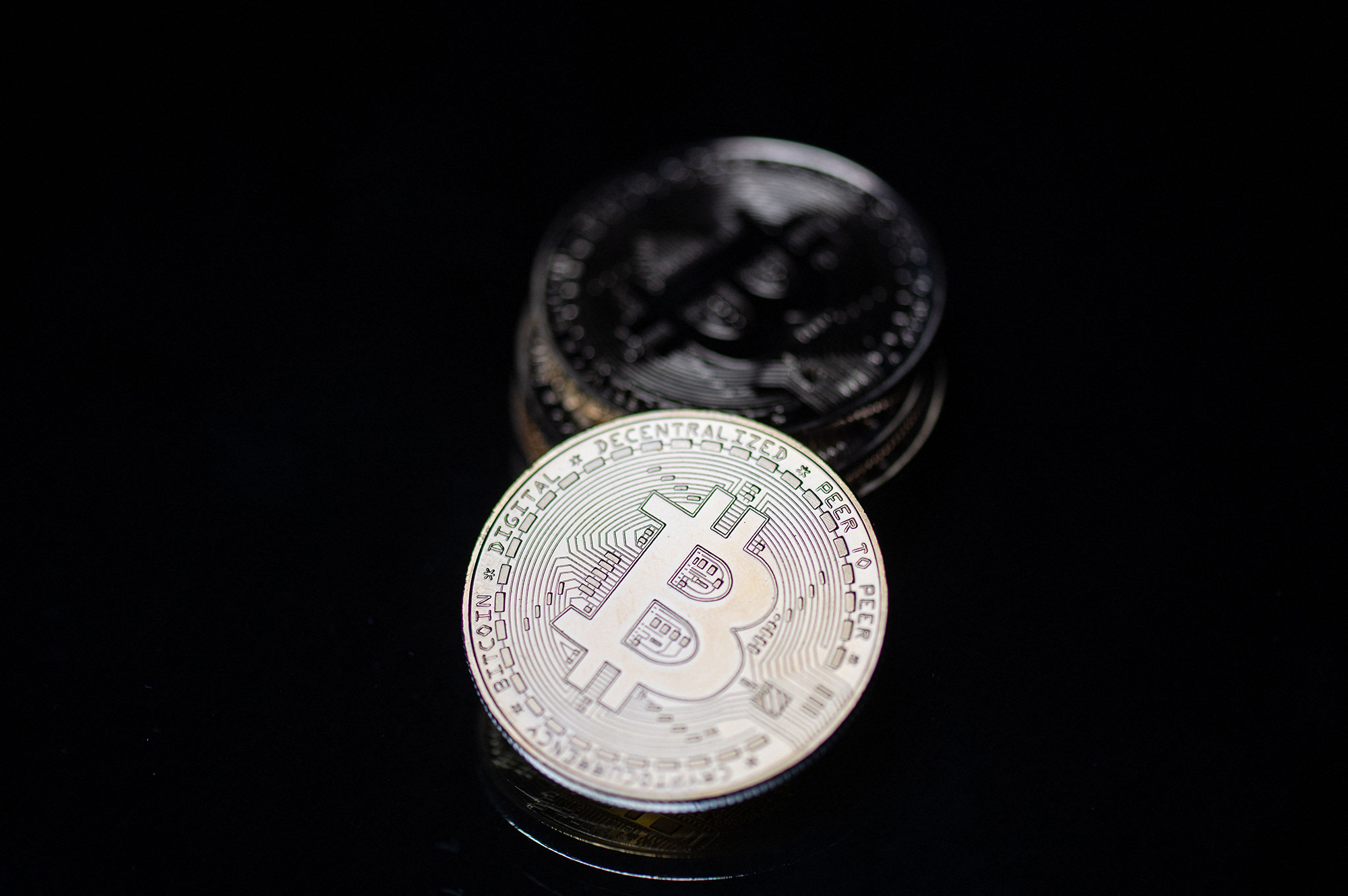 This photograph taken on April 26, 2021 in Paris shows a physical imitation of the Bitcoin crypto currency.
