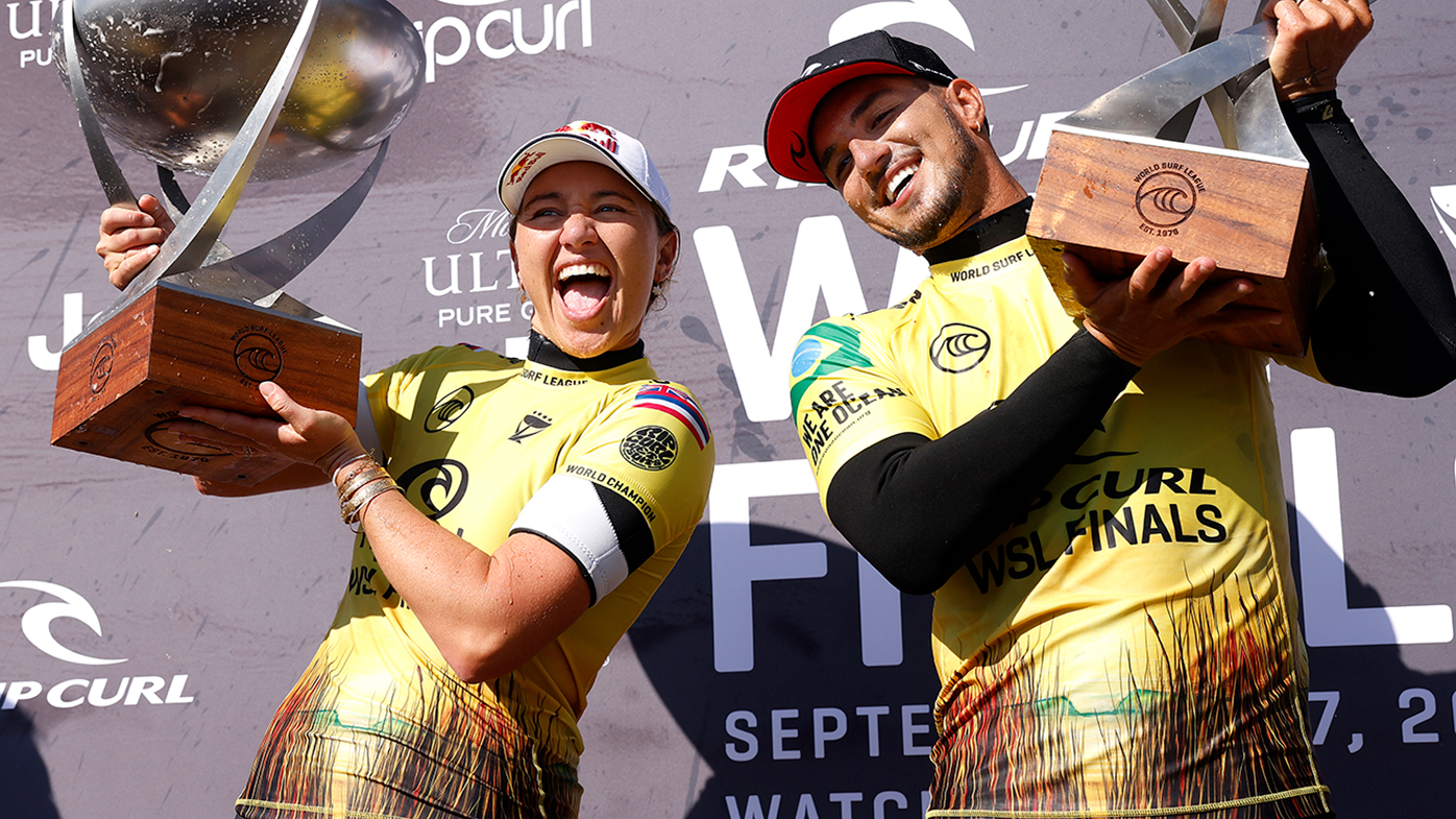Carissa Moore of the United States and Gabriel Medina of Brazil celebrate after winning the the Rip Curl WSL Finals at Lower Trestles on September 14, 2021 in San Clemente, California.