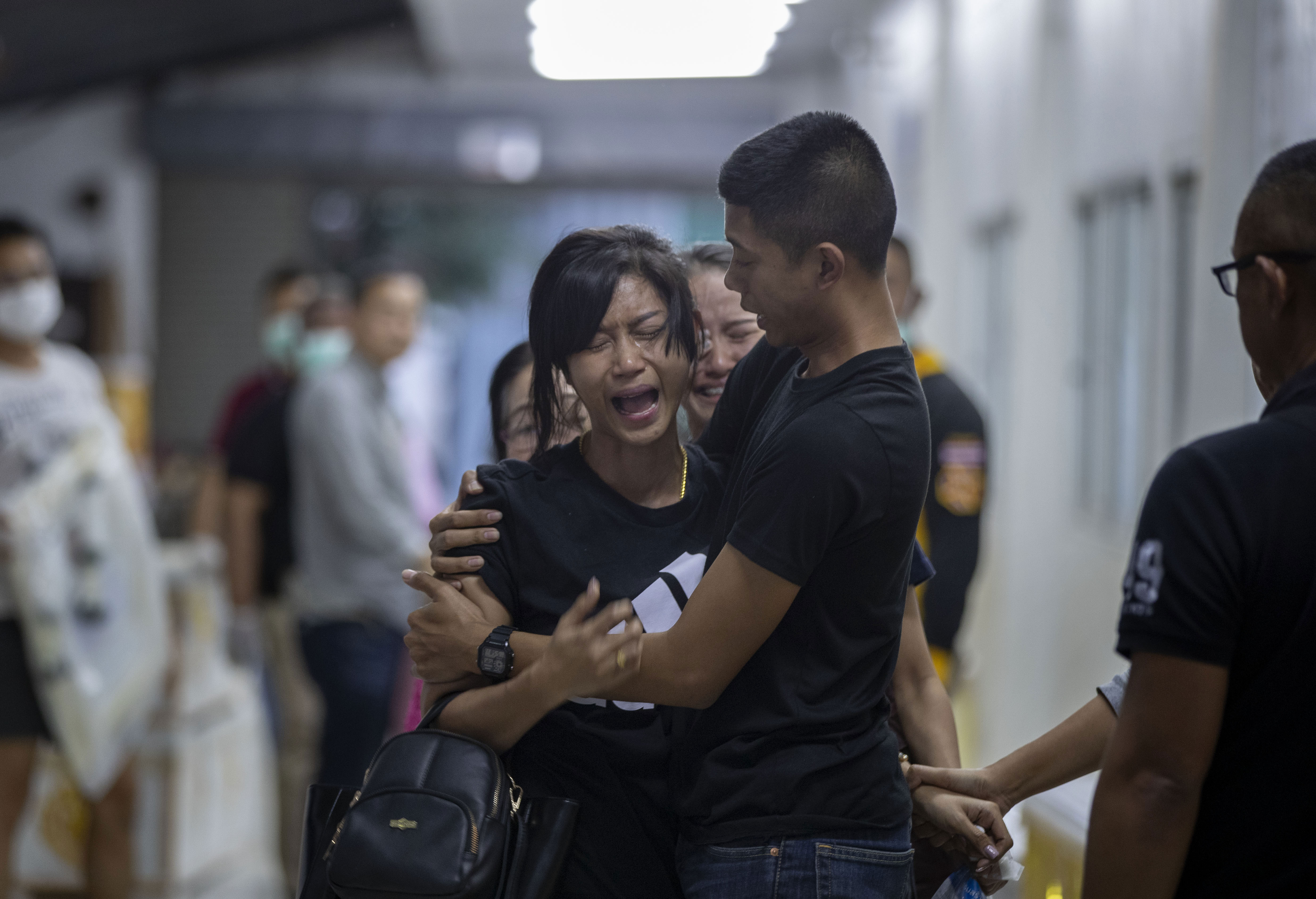 Relatives of a victim of a mass shooting react after visiting a morgue, in Korat, Nakhon Ratchasima, Thailand