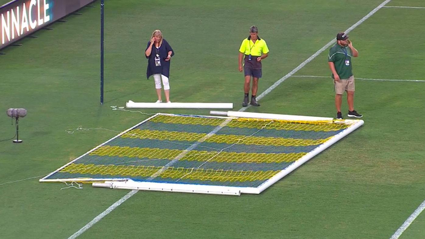 Mariners staff inspect the broken goal posts