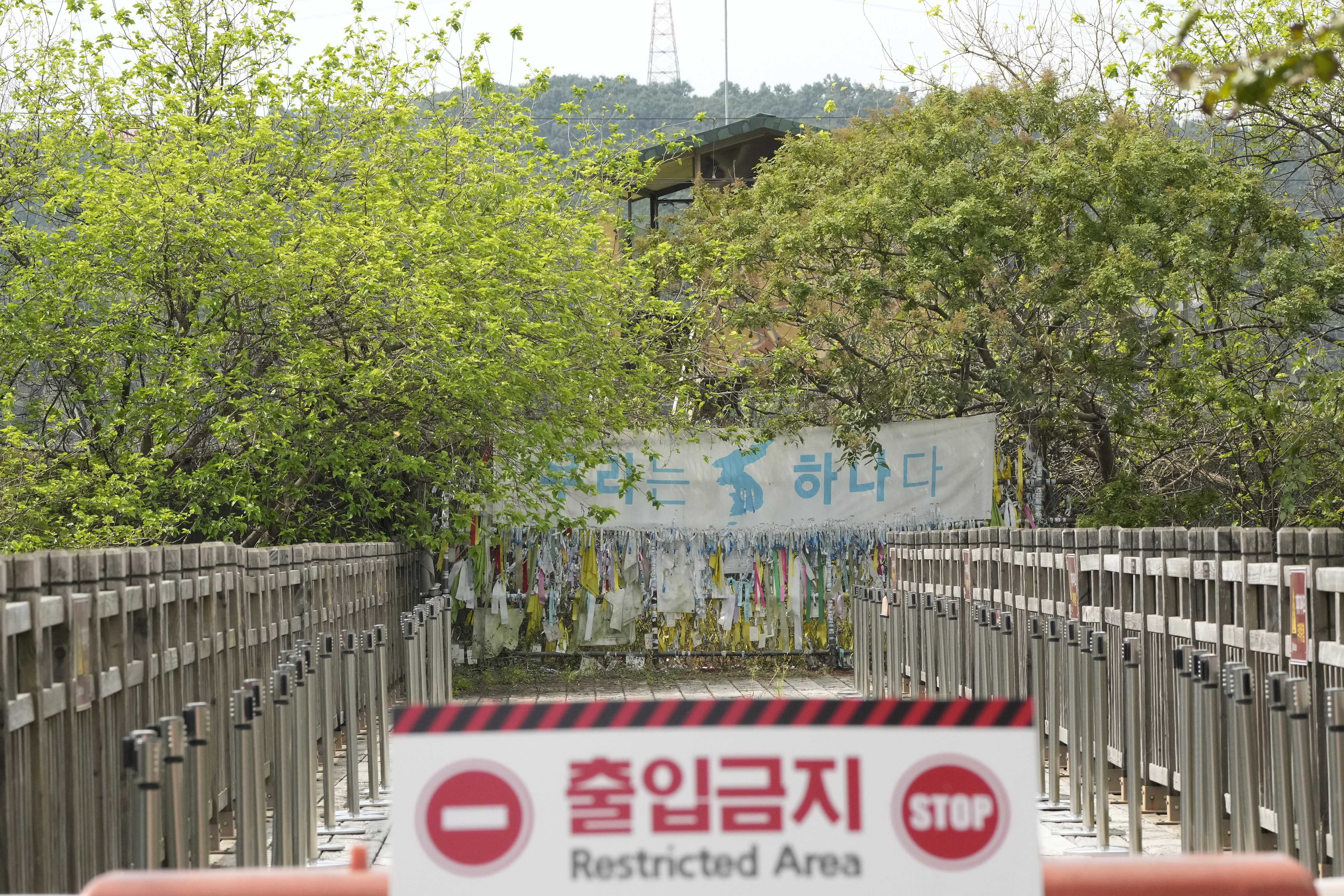 A banner and ribbons wishing reunification of the two Koreas are displayed on the wire fence at the Imjingak Pavilion in Paju, near the border with North Korea.