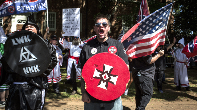 The Ku Klux Klan protests in Charlottesville, Virginia in 2017. The KKK is protesting the planned removal of a statue of General Robert E. Lee, and calling for the protection of Southern Confederate monuments.