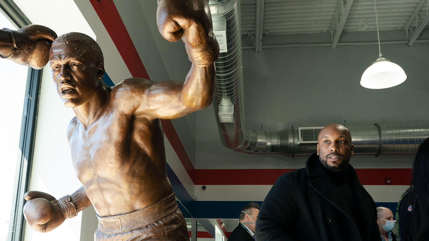 Joe Frazier Jr., looks at a statue of his father Joe Frazier, left, fighting Muhammad Ali, on the 50th anniversary of the boxers' World Heavyweight Championship boxing bout.