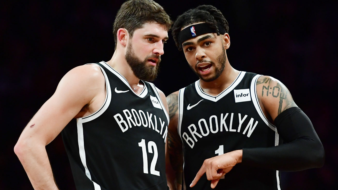 Harris with Russell last season in Brooklyn