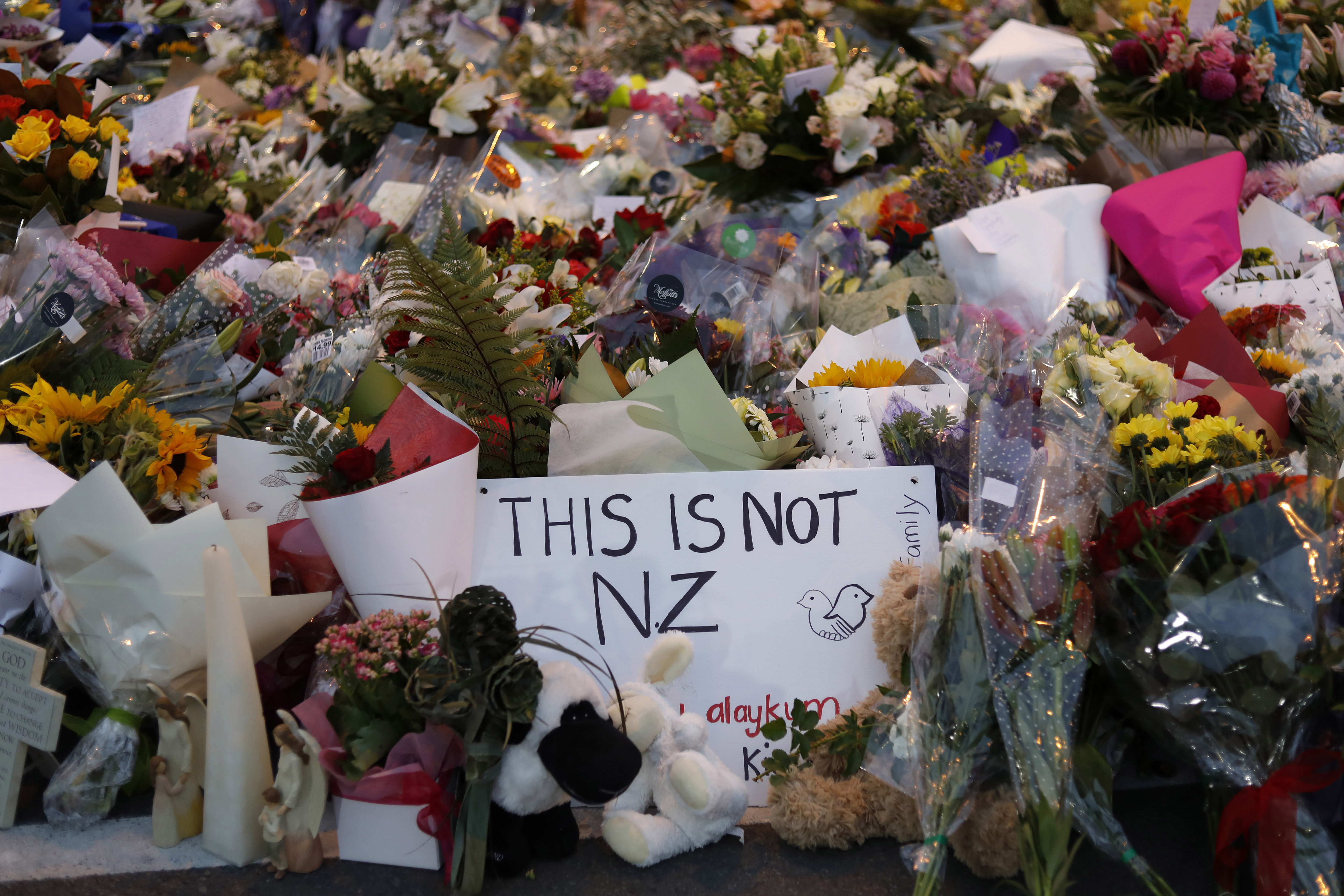 Flowers lay at a memorial near the Masjid Al Noor mosque for victims the day after the shooting.