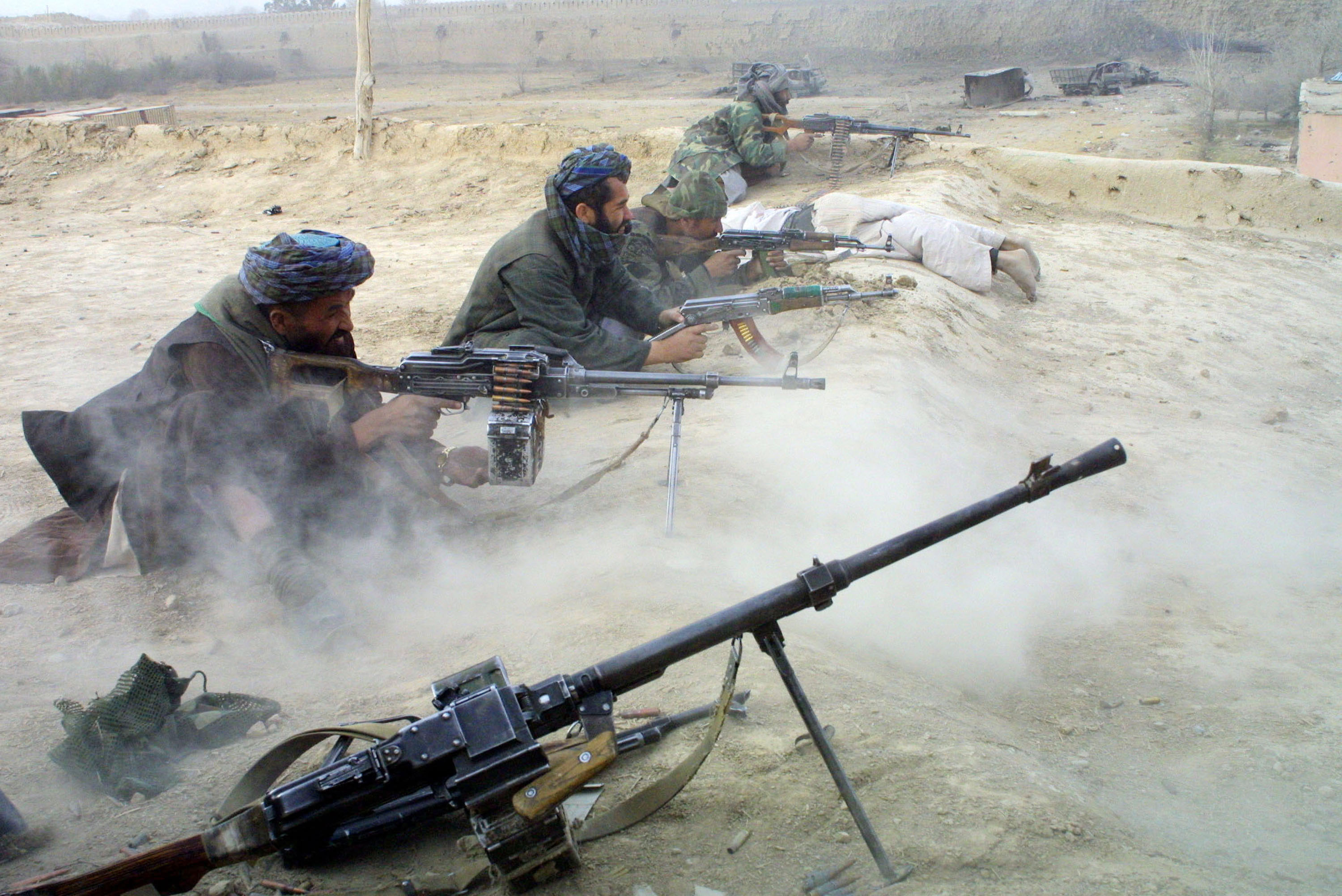Northern Alliance fighters battle pro-Taliban forces in 2001 in a fortress near Mazar-e-Sharif, Afghanistan.