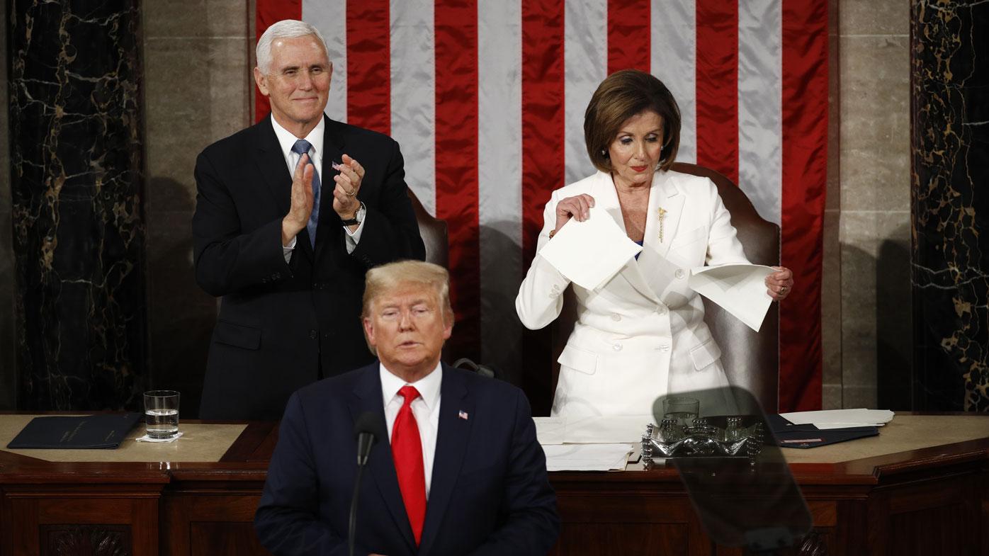 Nancy Pelosi tears Donald Trump's speech in half.