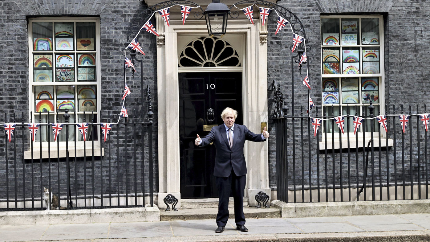 Britain's Prime Minister Boris Johnson poses for the media outside Downing Street, to mark the 75th anniversary of VE Day, in London, Friday, May 8, 2020