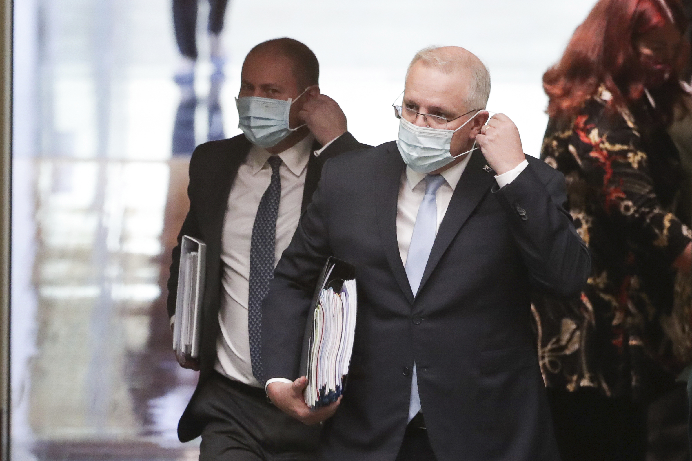 Masked MPs return to parliament as aged care furore rages