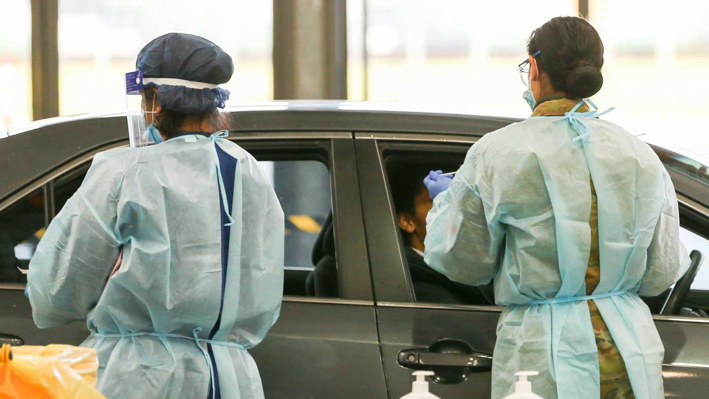 People get tested for Covid-19 at a drive through testing site at Flemington.