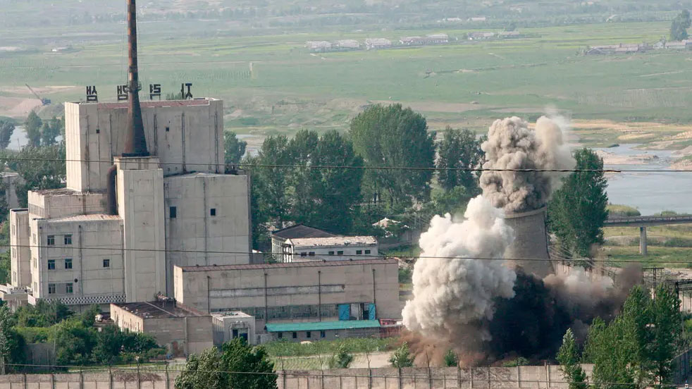 In this June 27, 2008, file photo released by China's Xinhua News Agency, the cooling tower of the Yongbyon nuclear complex is demolished in Yongbyon, North Korea.