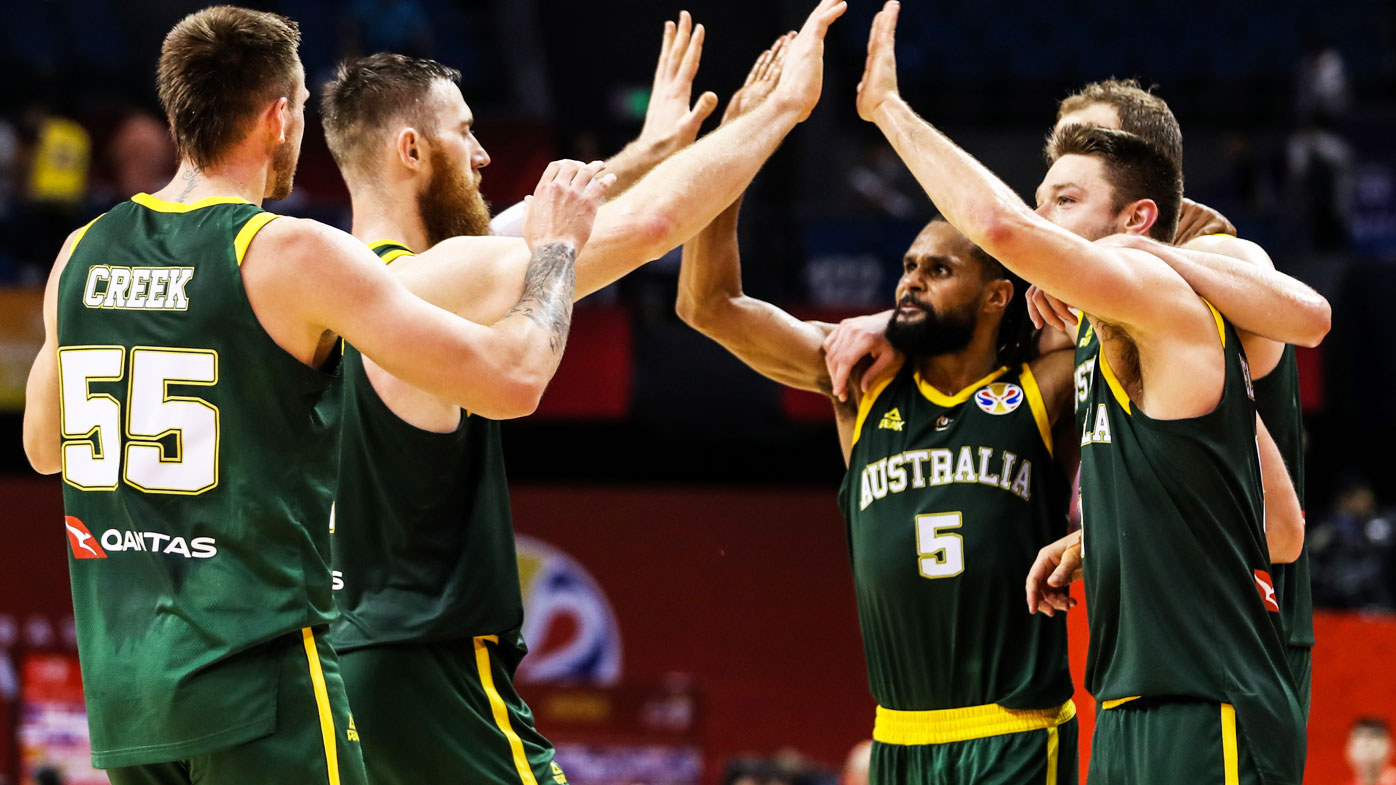 The Boomers celebrate the victory during 2nd round Group L match between Australia and France