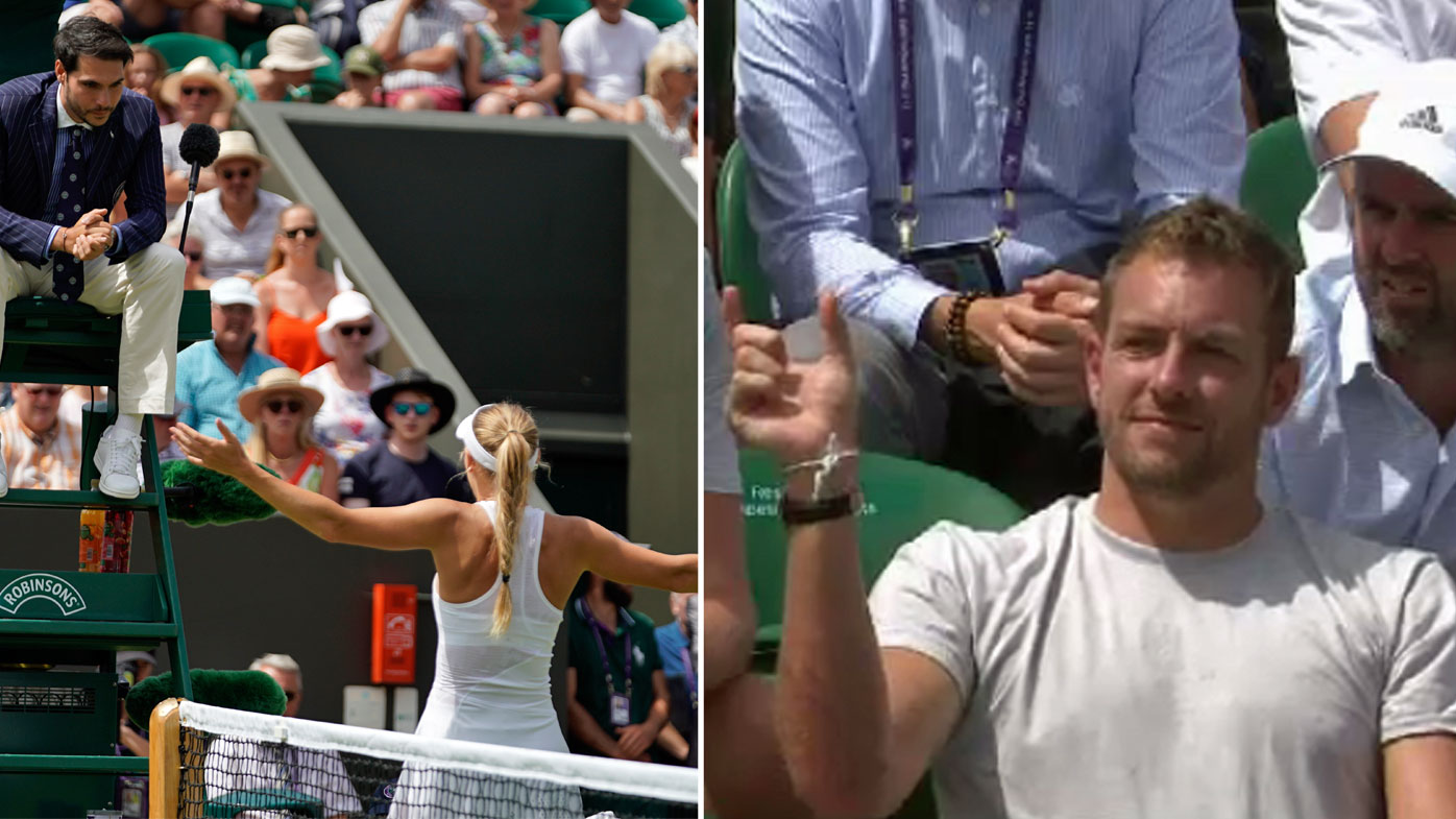 Wozniacki argues with the umpire as her husband looks on