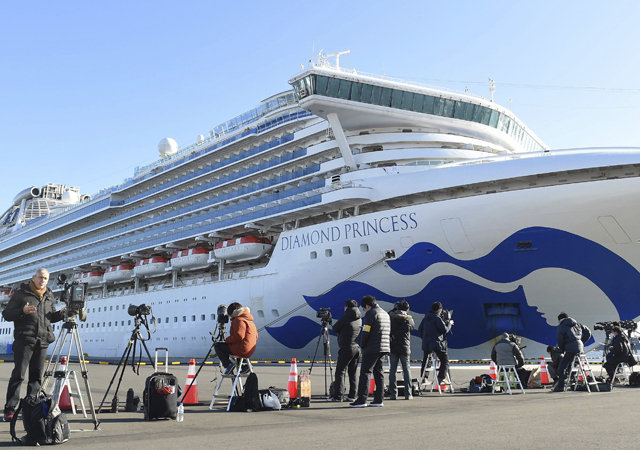 The Princess Diamond which 64 passengers and a crew have been found positive in a new type coronavirus test anchors at Daikoku Wharf in Yokohama